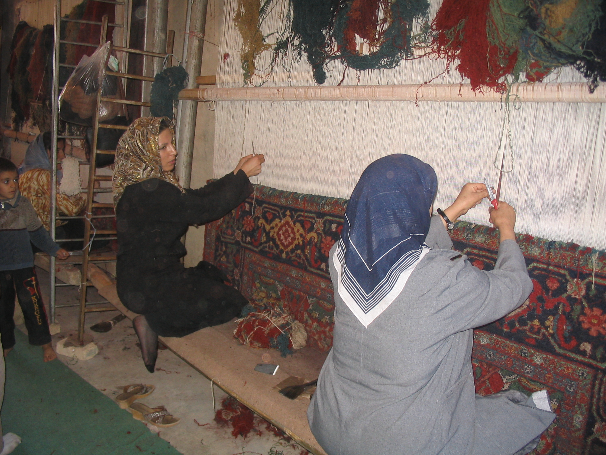 #21) Persian weavers, Bijar area.