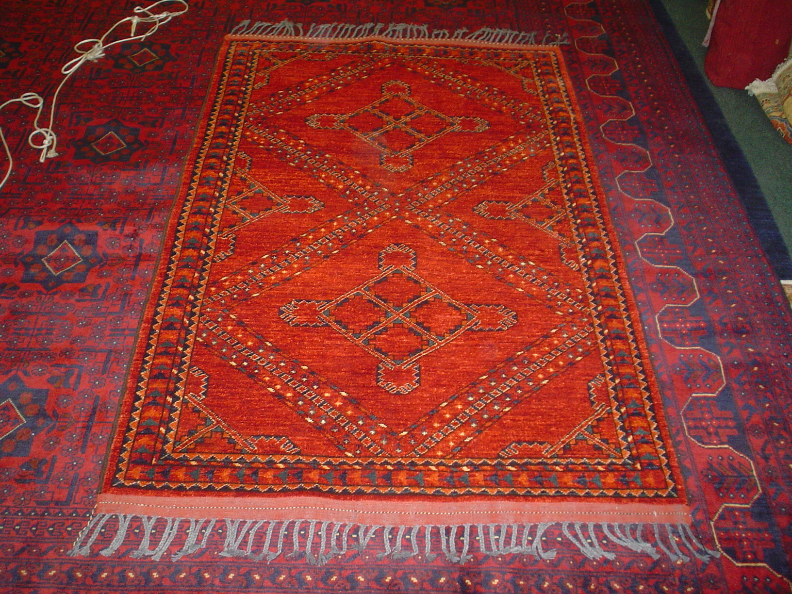 Amazing 4 x 6 Afghan rug. In and out in one day! Sold. Woven with all plant based vegetable dyes the red/orange colors and lovely diamond design with blue/green accents is fantastic.