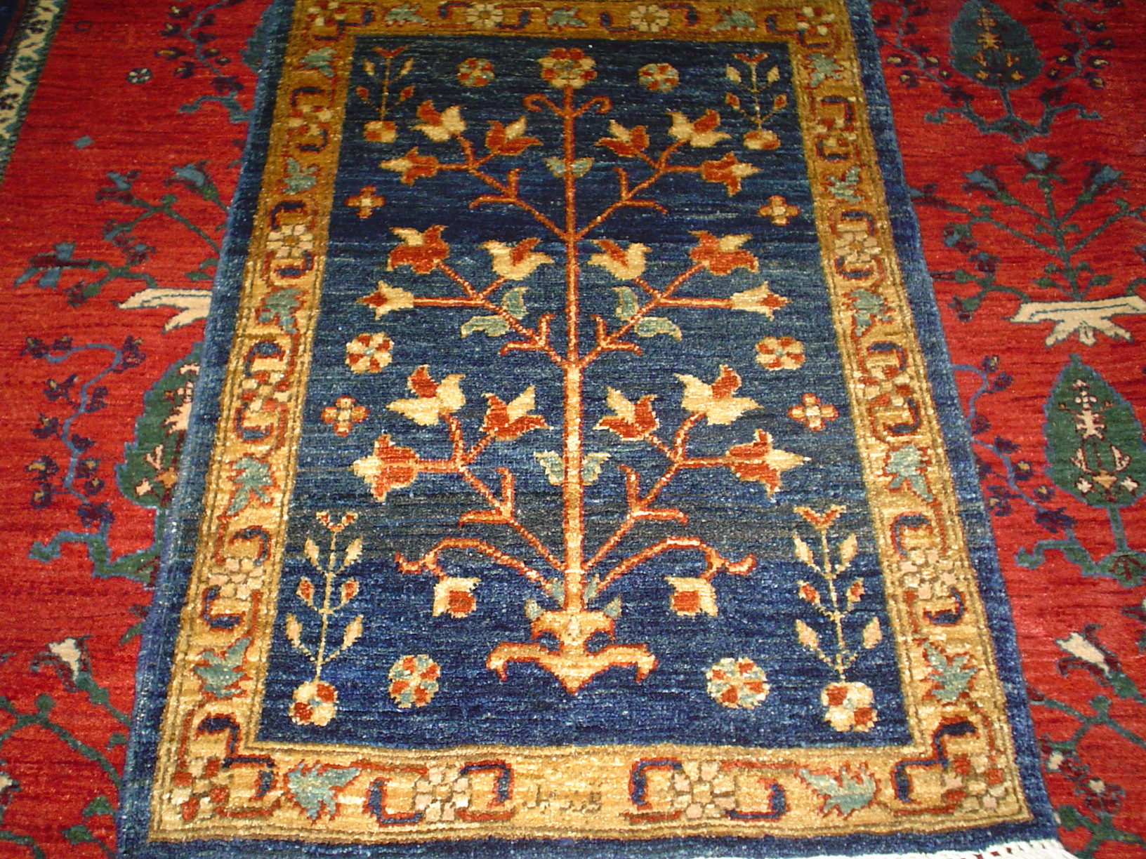 2.4 x 3.2 Navy Tree of Life rug, Afghanistan. Charming little rug. Available. At the shop.