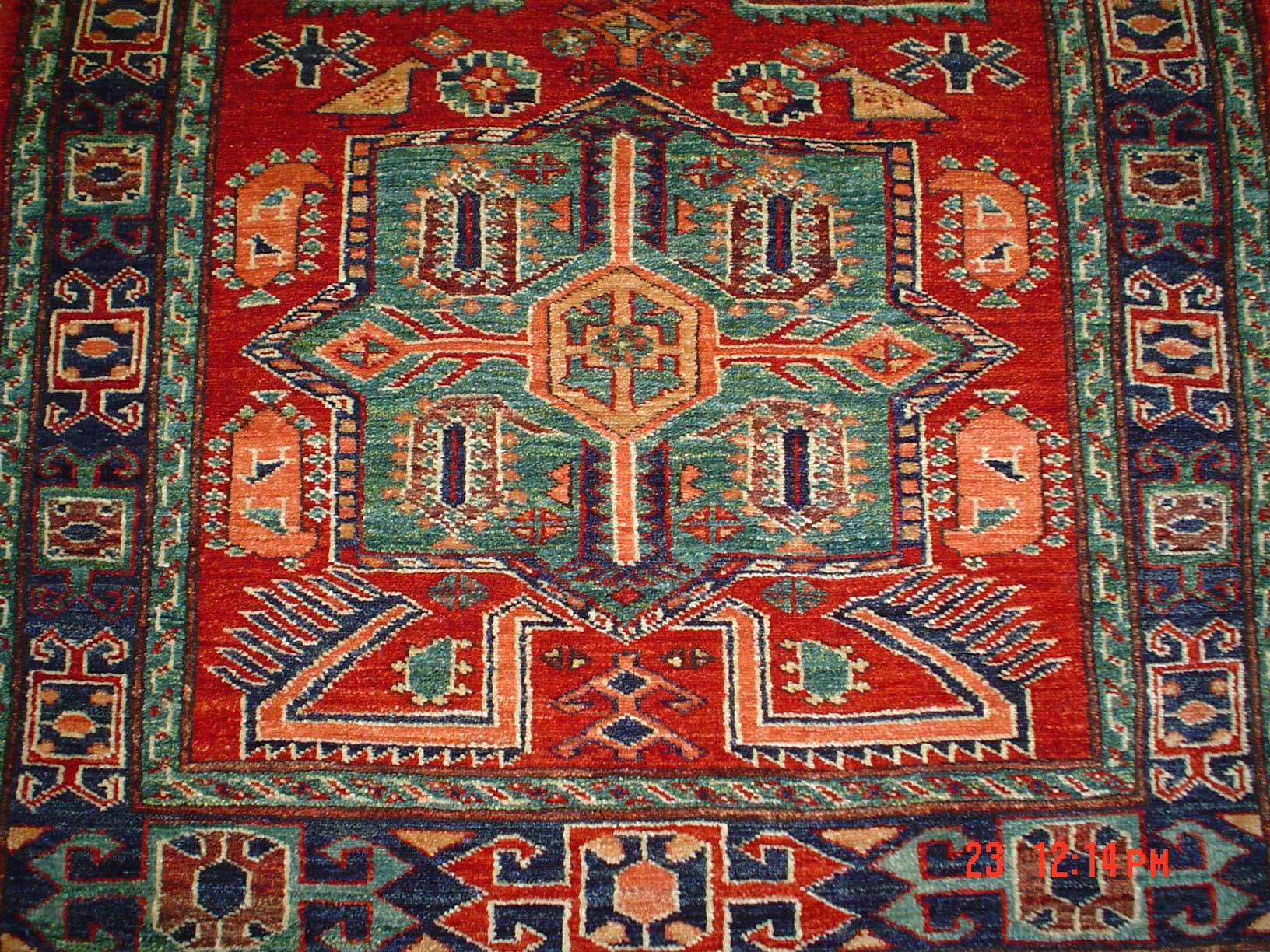 3 x 5 Kazak with the Akstafa Peacock design. Sold.