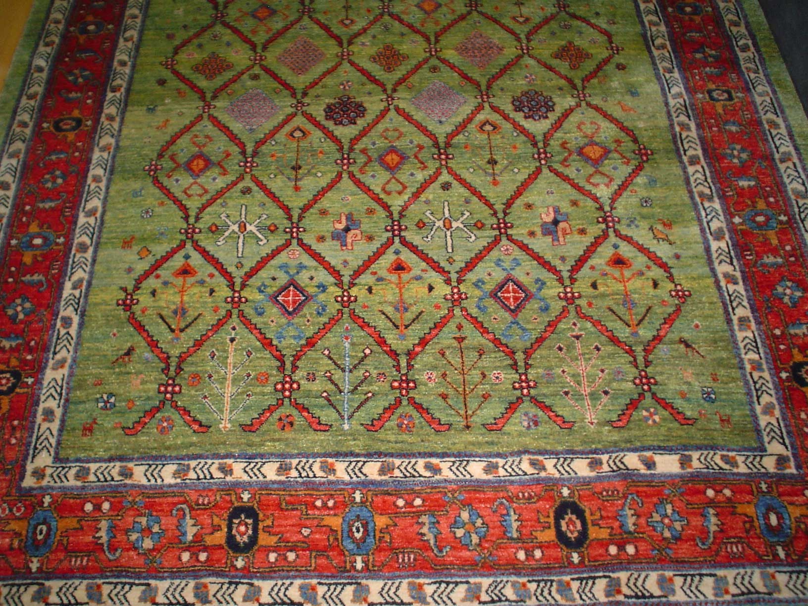Beautiful 5 x 7 Persian Qashqai rug in light green. Sold.