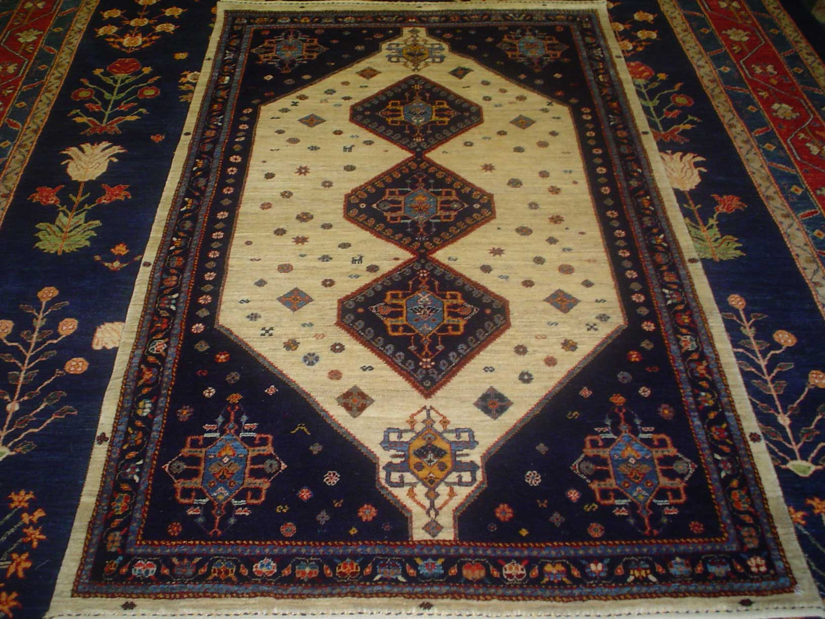 4 x 6 Persian Qashqai. Classic tribal design, navy on an ivory ground in soft hand-spun Persian wool.