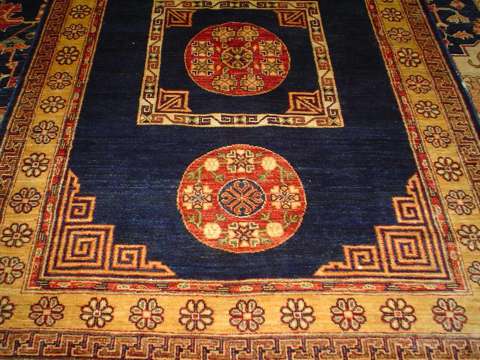 "5' x 6'5"" Khotan rug in an antique design from East Turkestan. Sold."