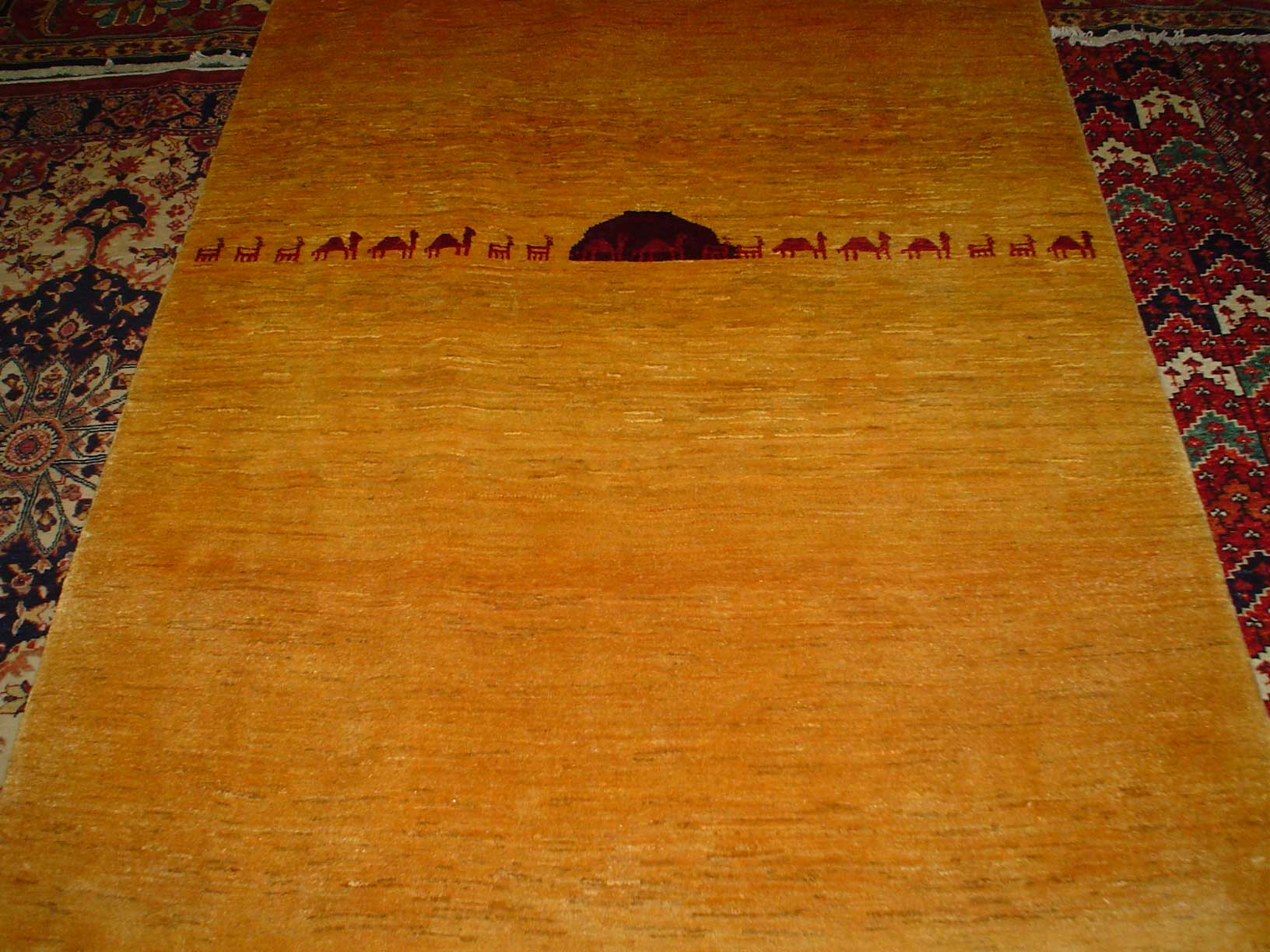 "4'1"" x 5'9"" Gabbeh with camels in yellow with red accents."