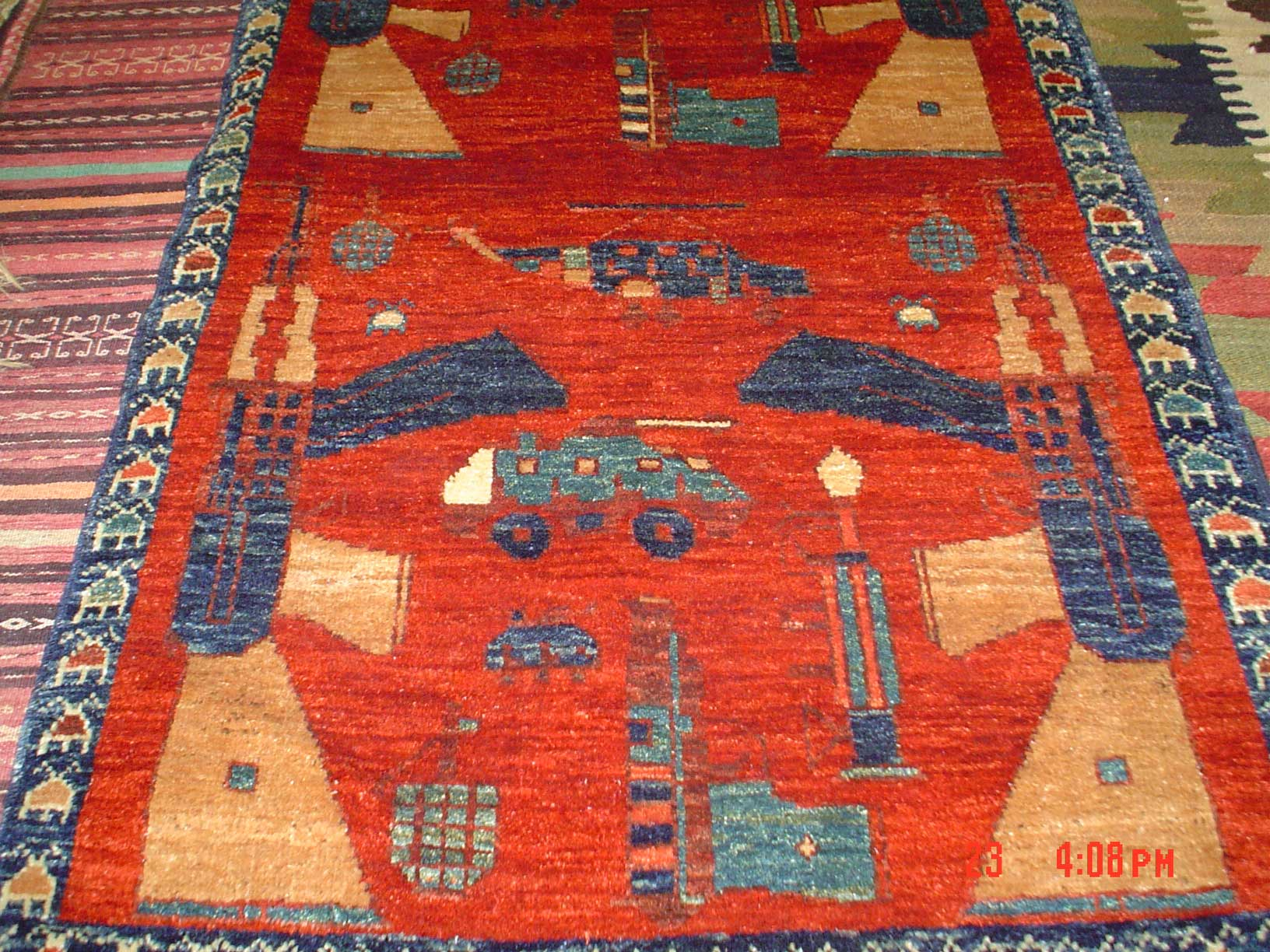 Afghan WAR RUG, veg dyes, hand-spun wool. AK 47's & tanks! Sold.