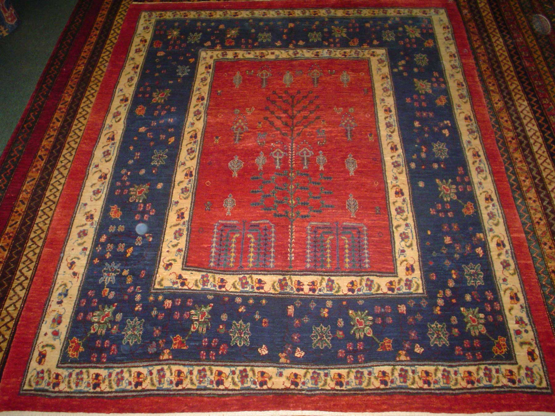 "Beautiful Tree of Life design. Persian Khamsehbaf. The exact size on this rug is 5'1"" x 6'4"". Sold."