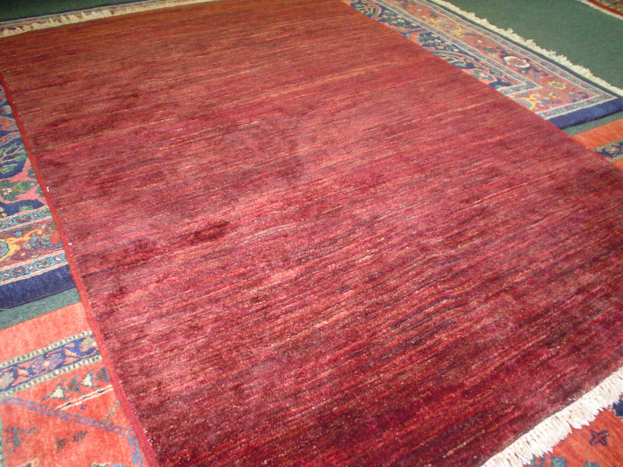 "#7) 3'2"" x 4'9"" Afghan Modern in deep variegated reds."