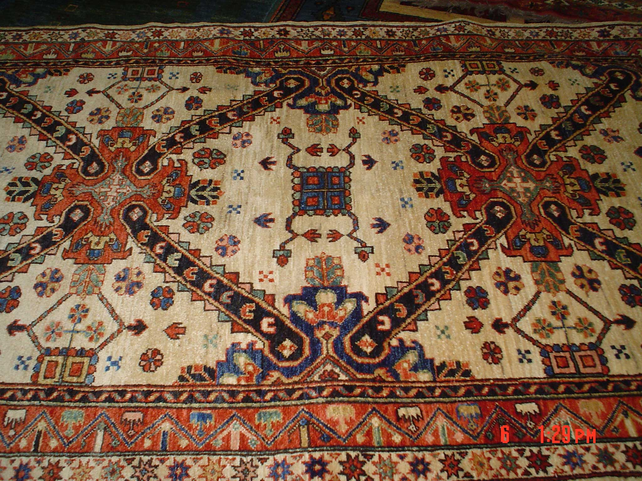"#12) 4'2"" x 6'10"" Kuba. Old design, new rug, woven in Afghanistan."