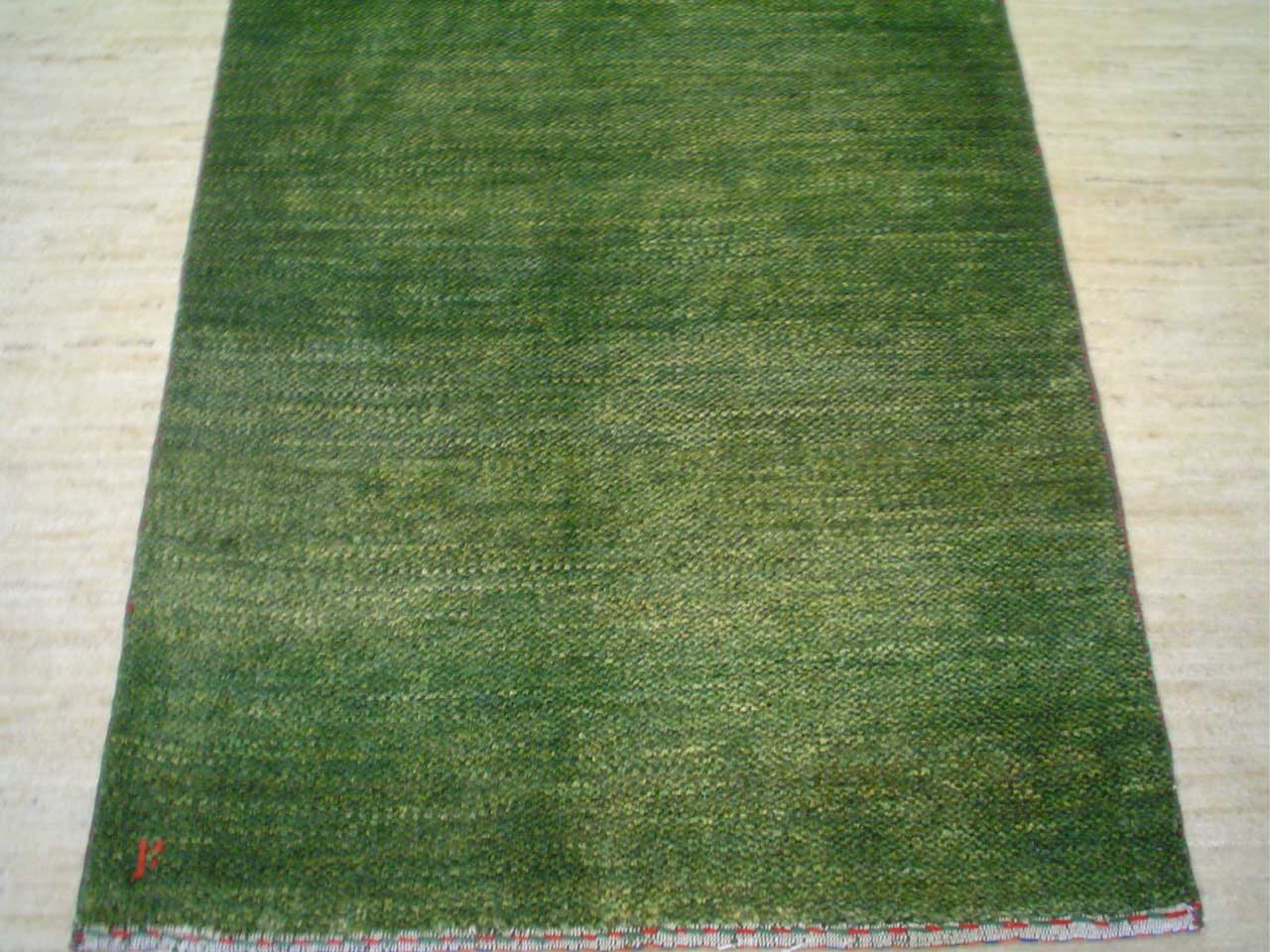 "#17) 2'7"" x 4'1"" light green Persian Gabbeh rug."