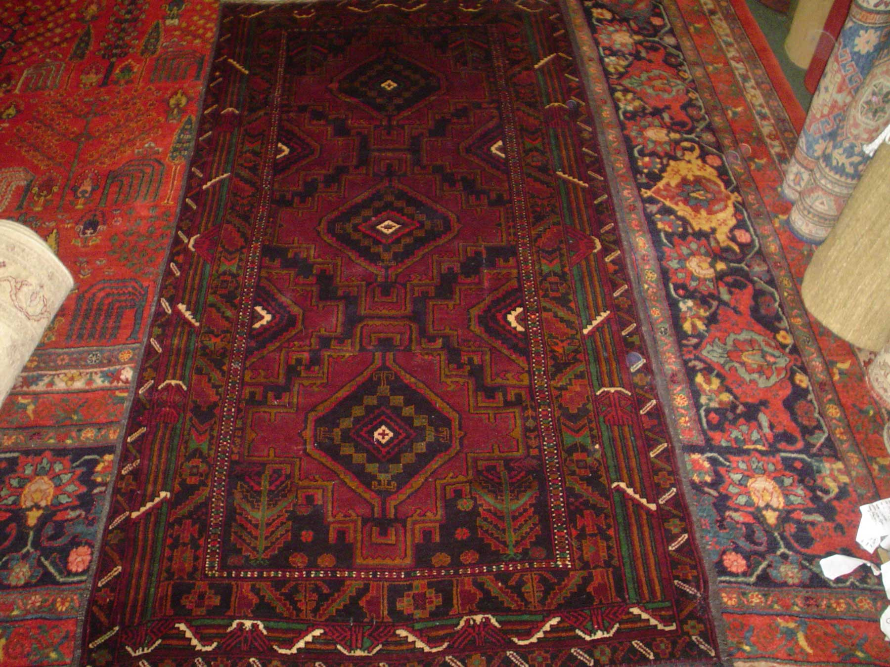 """#9) 3'5"""" x 6'9"""" finely woven Balouch rug."""