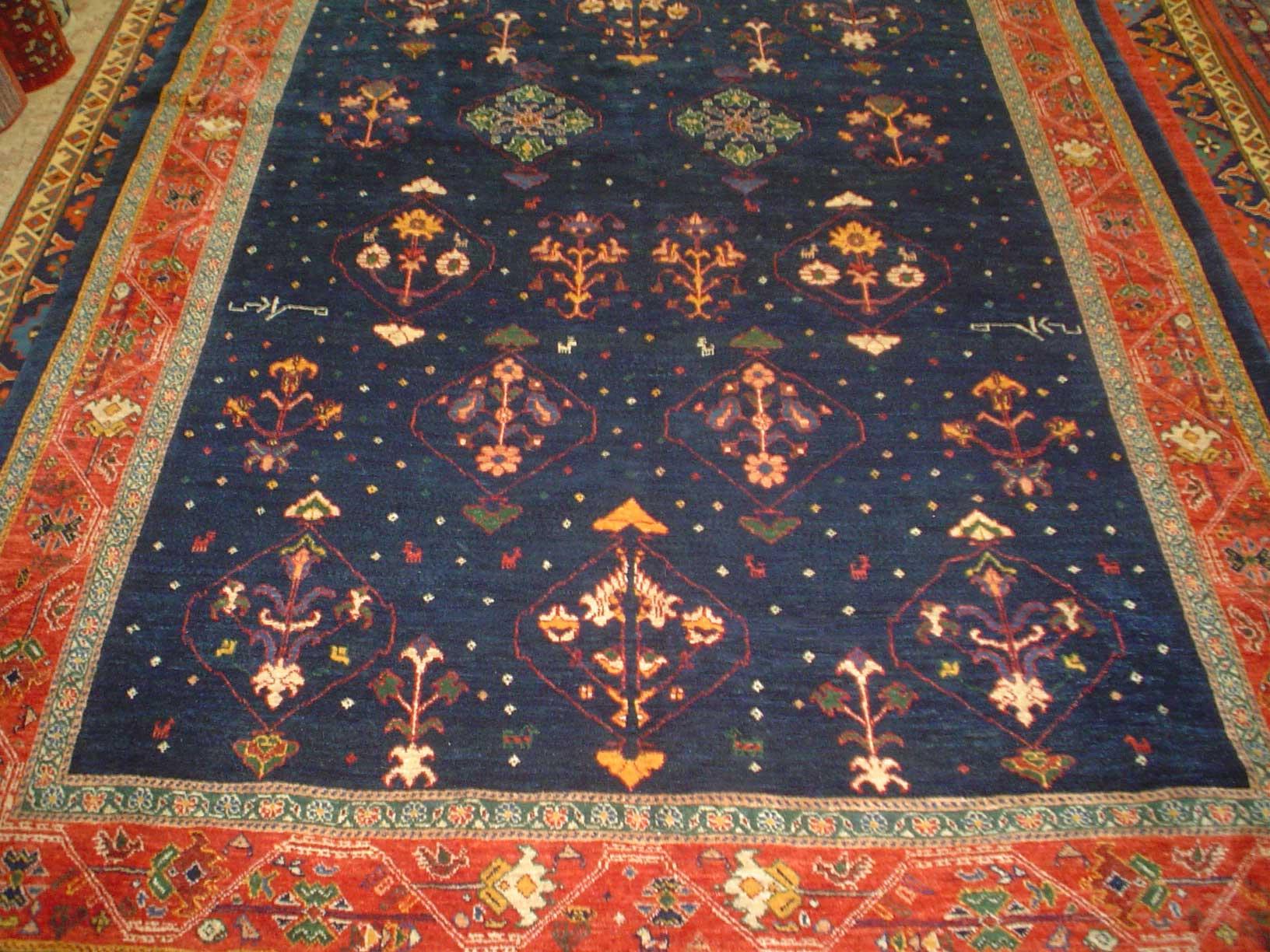 Truly wonderful 6 x 8 Persian tribal rug. Khamsehbaf. Navy with detailed tribal designs and a dark red border.