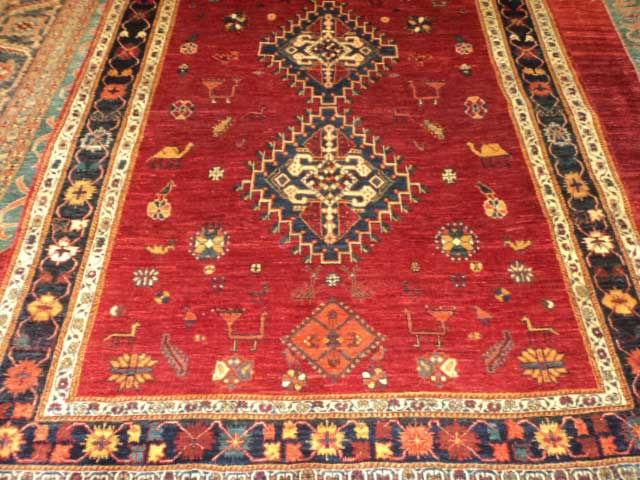 5 x 7 Persian Qashqai. Beautiful colors and fine quality wool. Sold. Luscious deep red ground with animals and human figures placed whimsically!