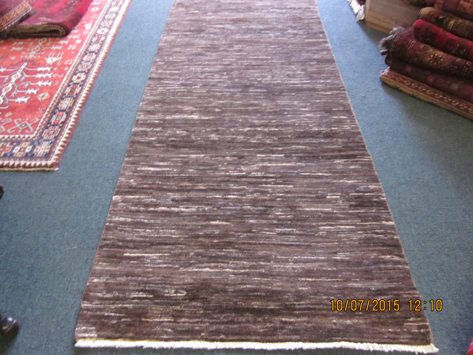 #25) 3' x 9'2' Modern Afghan runner in a warm coco brown with ivory.