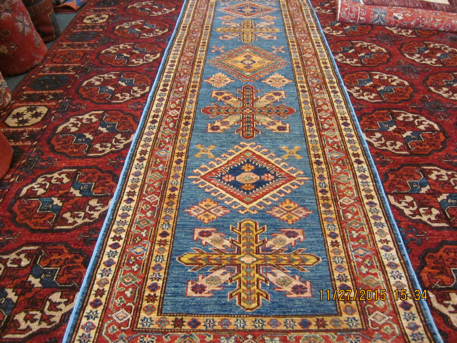 "#26) 2'5"" x 7'3"" Blue Kazak runner."
