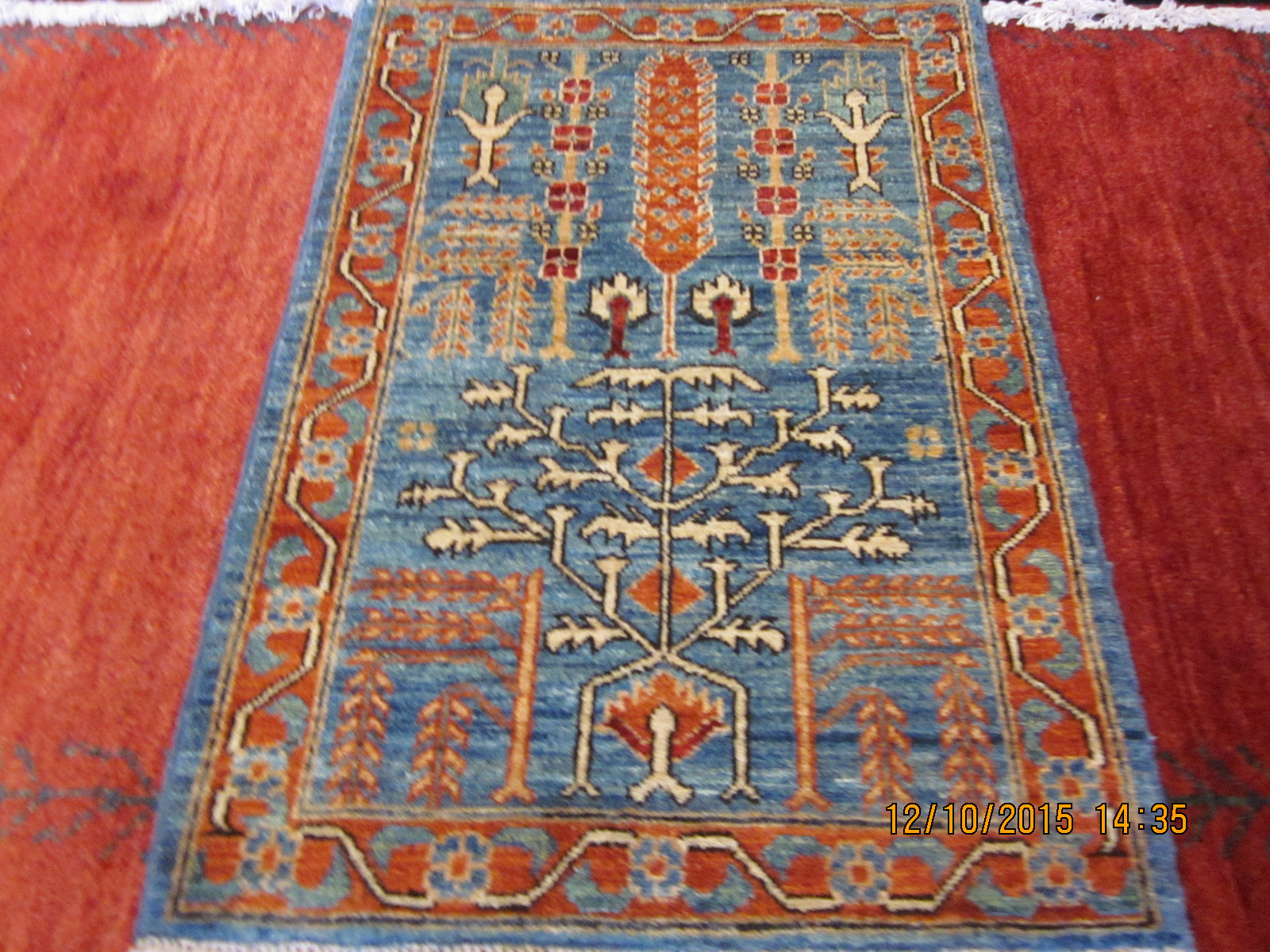 #28) 2' x 3' Tree of Life rug in light blue.
