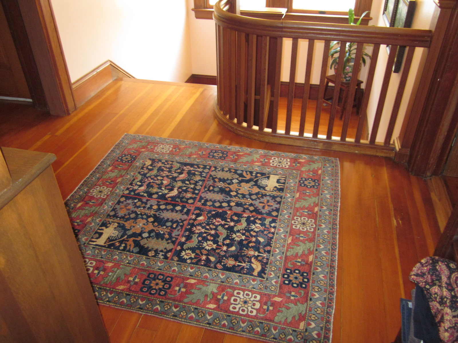 Small Qashqai rug in client's home.