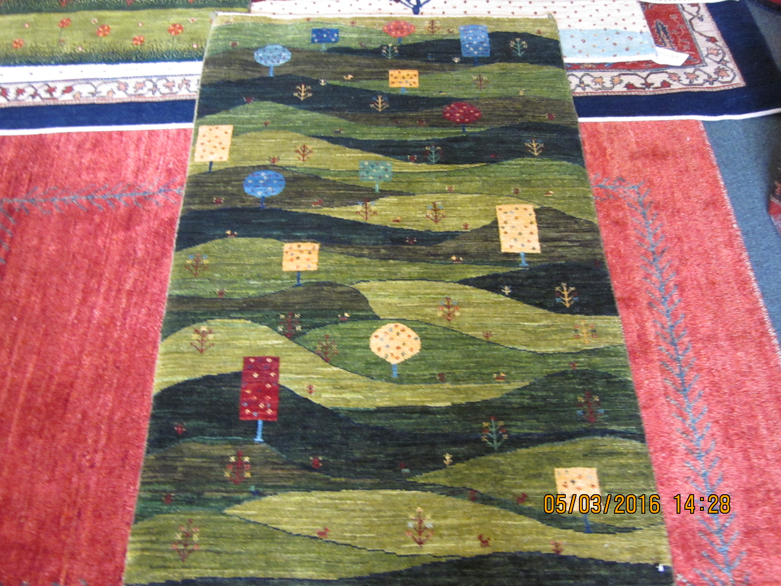Small green Gabbeh rug recently sold
