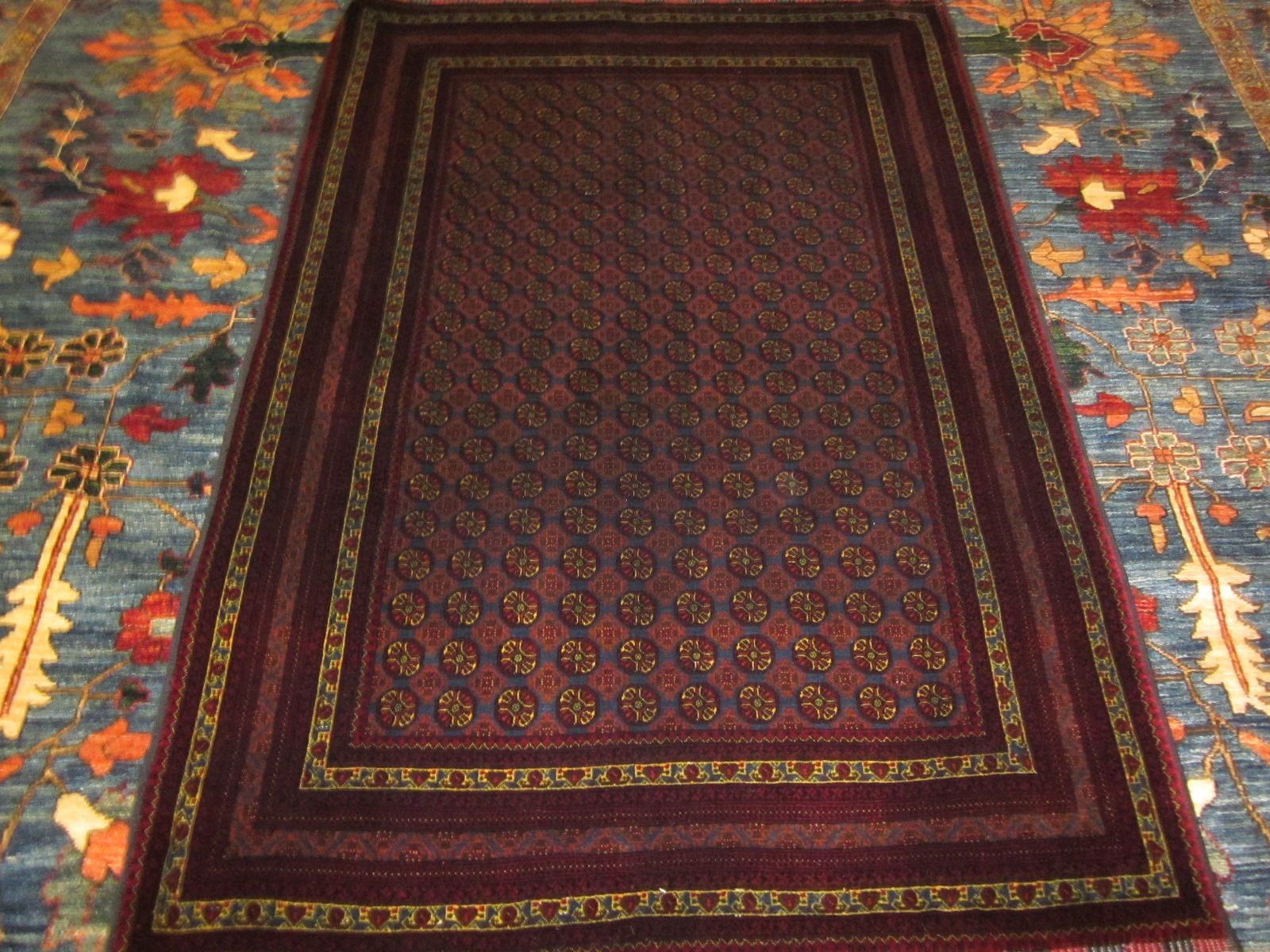 Finely woven Turkoman rug, small piece, 3 x 5 with deep reds and blues. Sold.