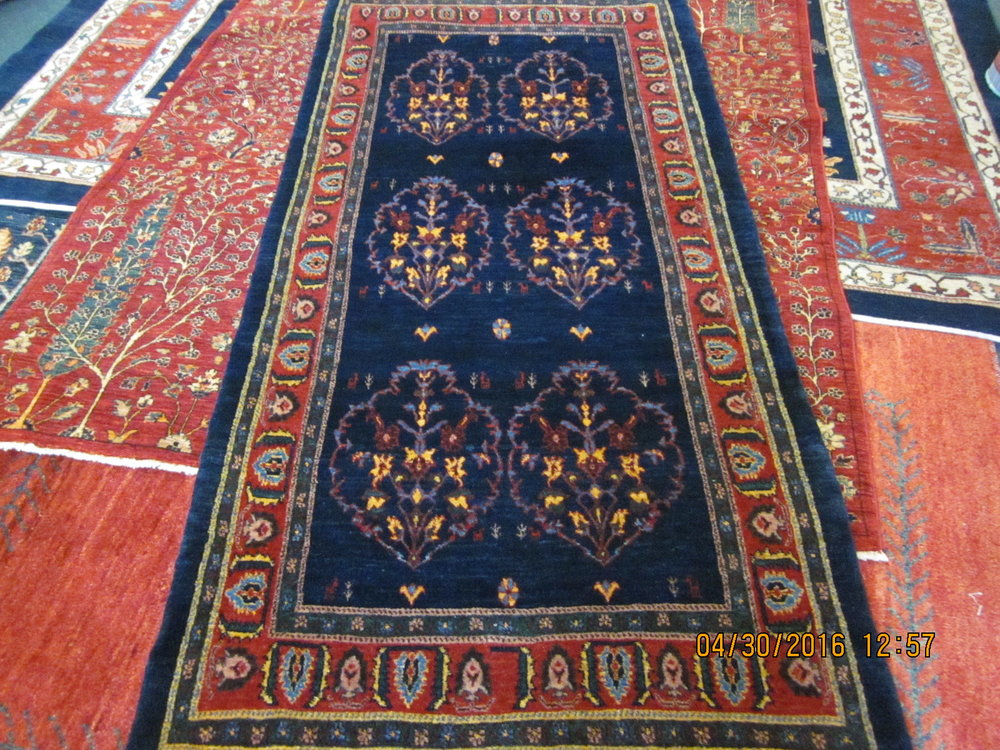 "#38) 3'2"" x 6'9"" Persian tribal runner."