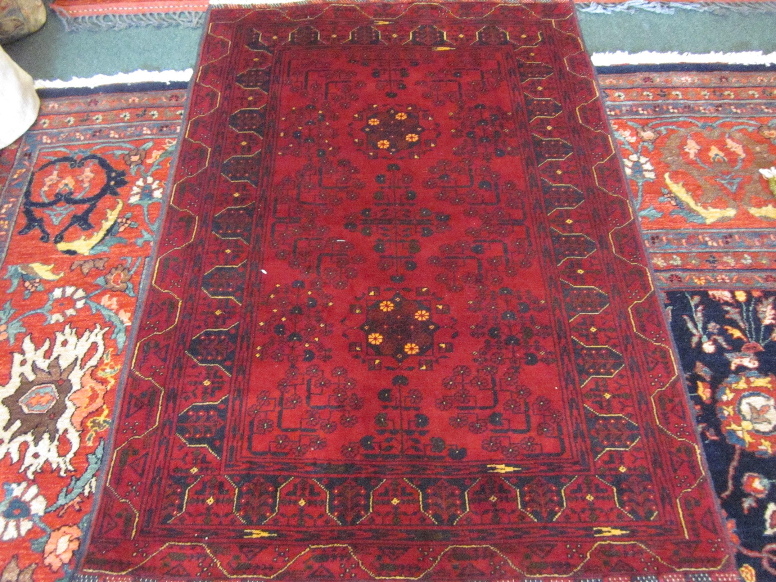 "#36) 3'3"" x 5' Turkoman rug."