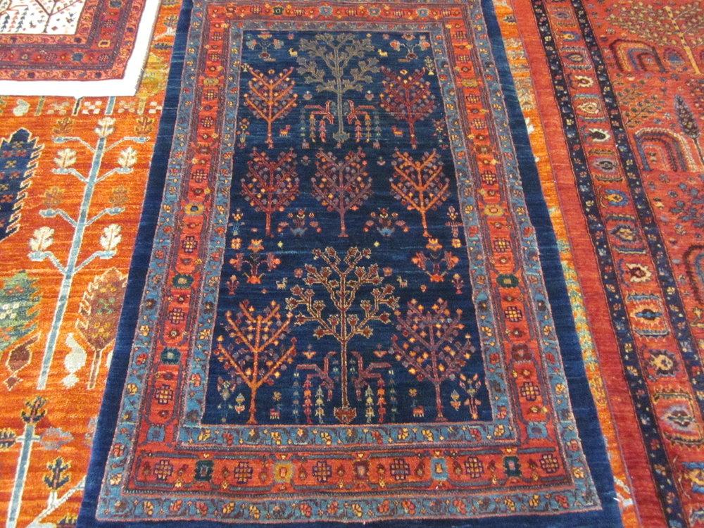 "2'8"" x 4'5"" Navy Persian Tree of Life rug."