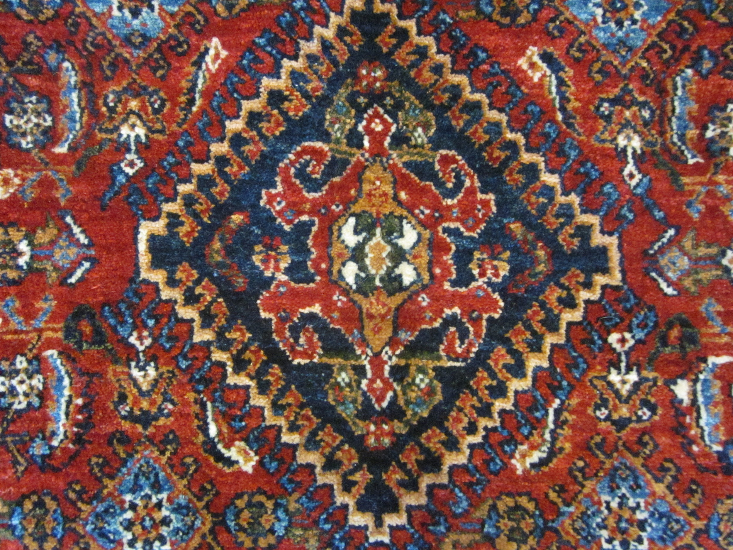 #48) Qashqai rug, close-up photo.