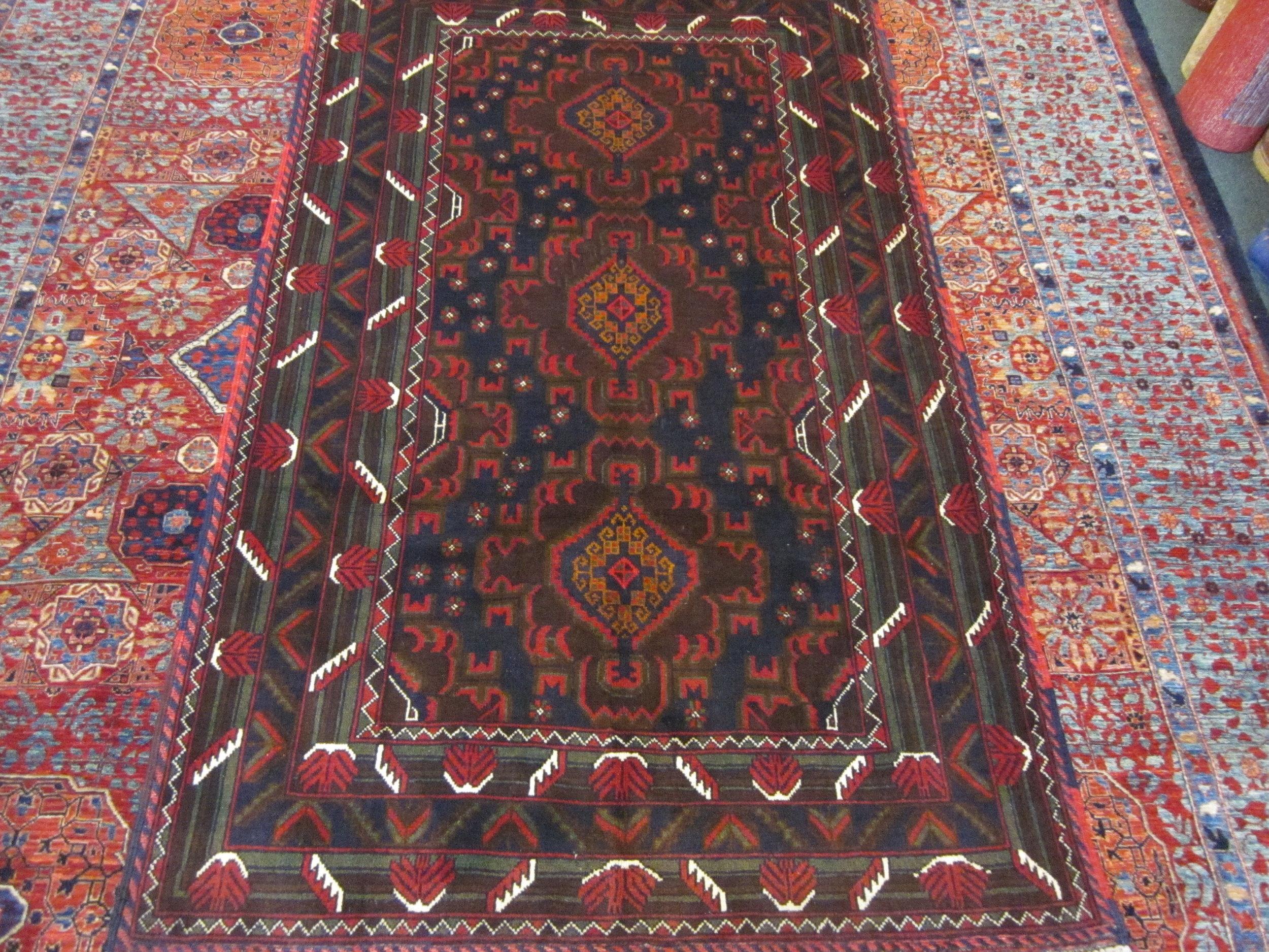"""#49) 4' x 6"""" Balouch rug."""