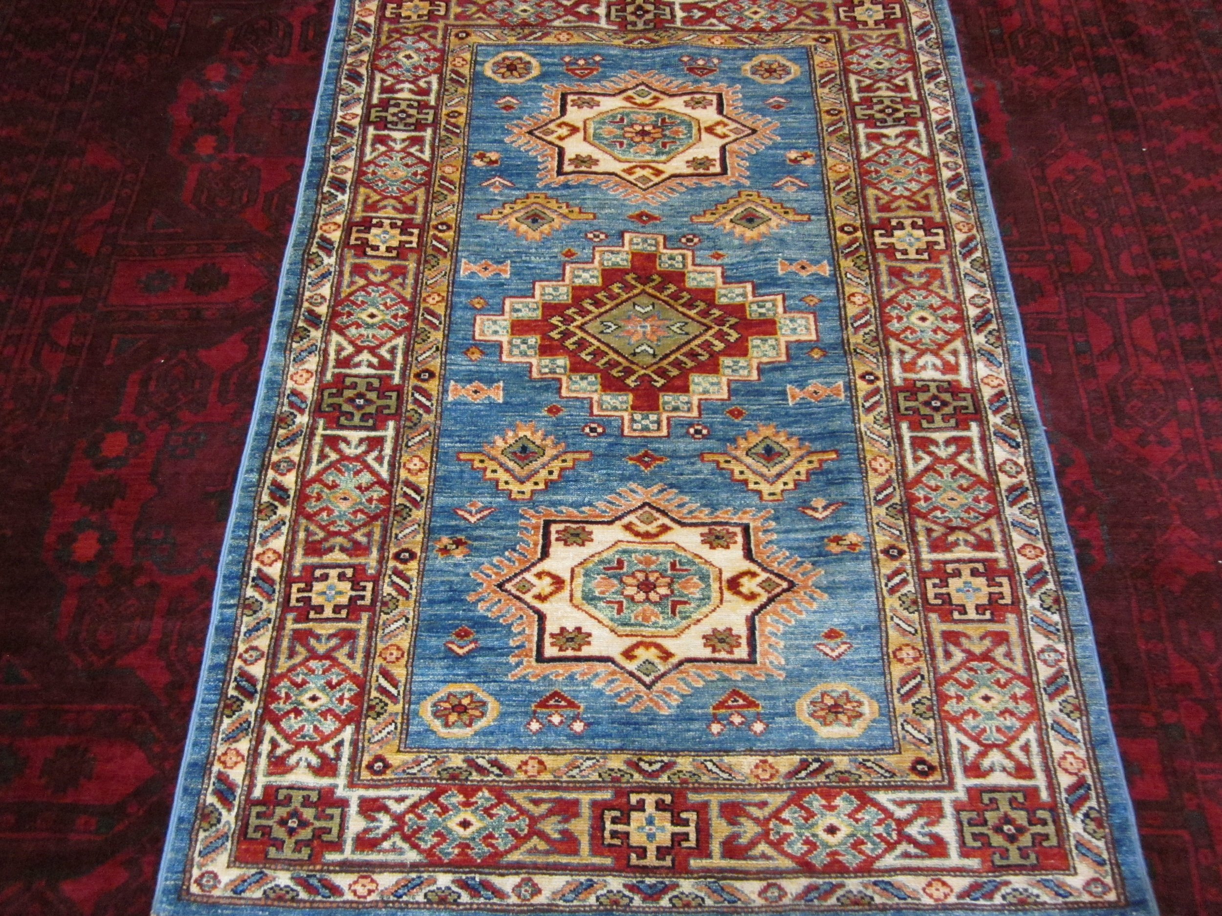 "#42) 3'3"" x 4'9"" Light blue Kazak rug."
