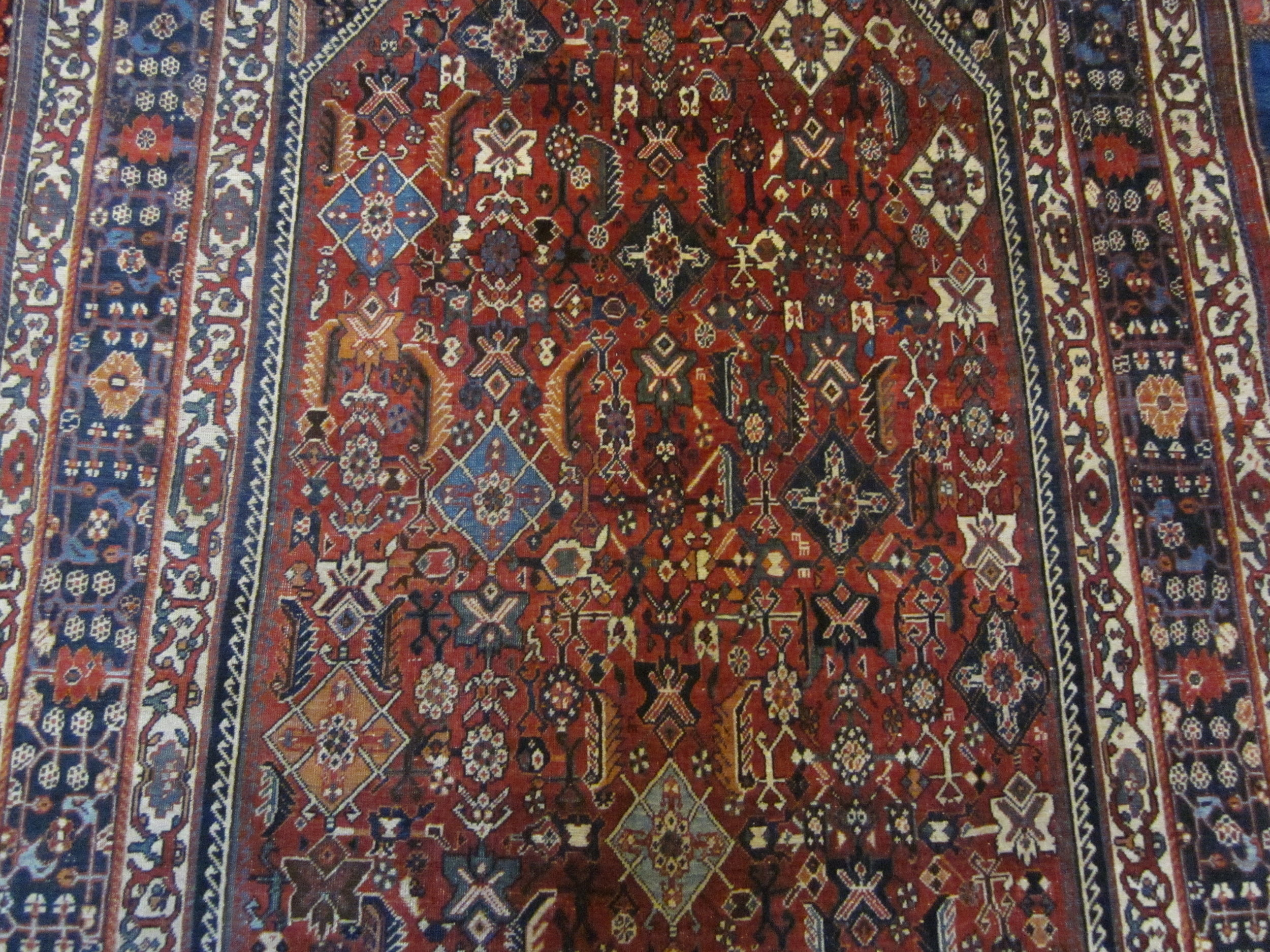 "Close-up photo, antique 5'4"" x 8'7"" Qashqai rug."