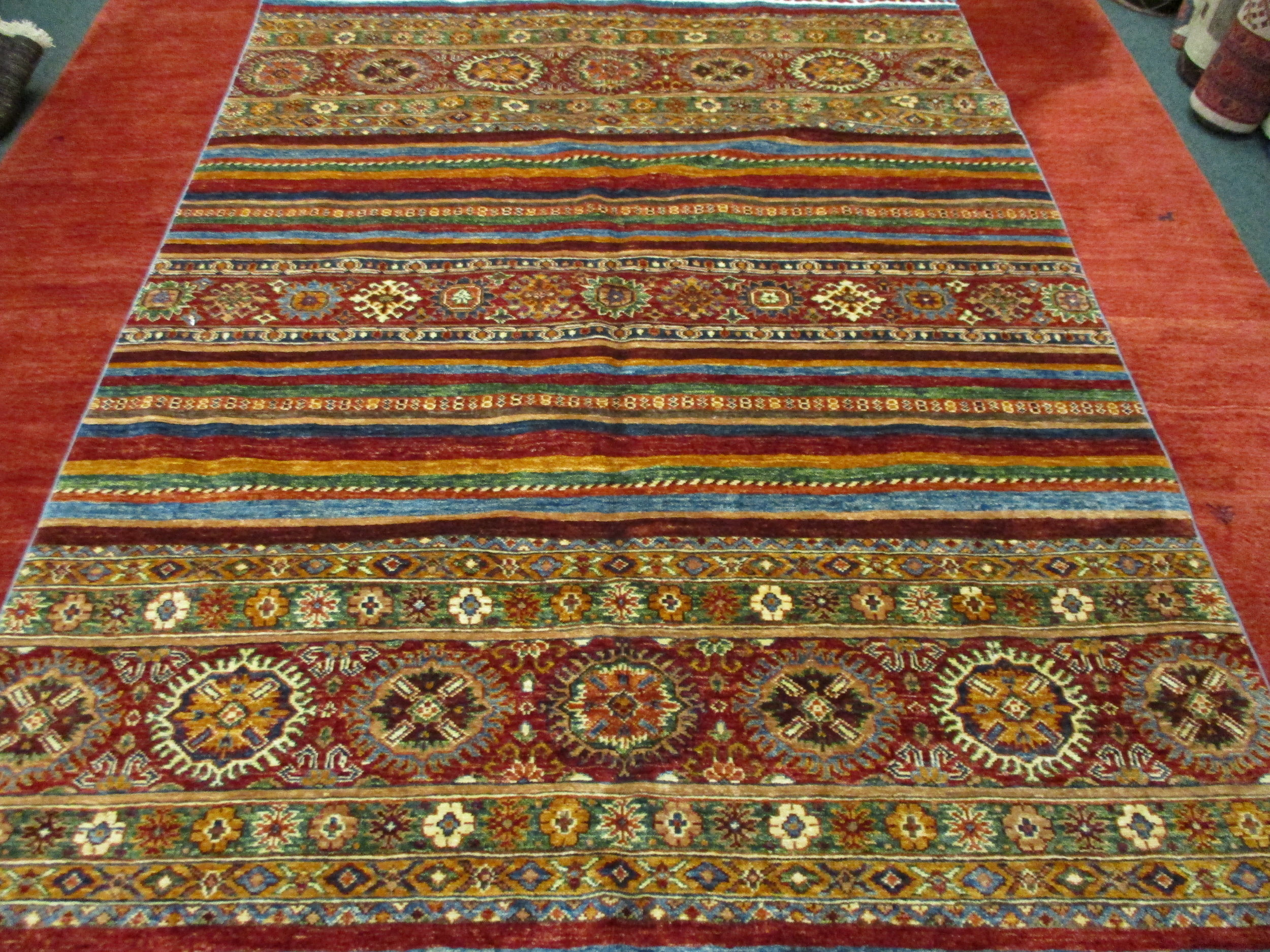 #45) 6 x 8 Afghan rug. Tribal design.