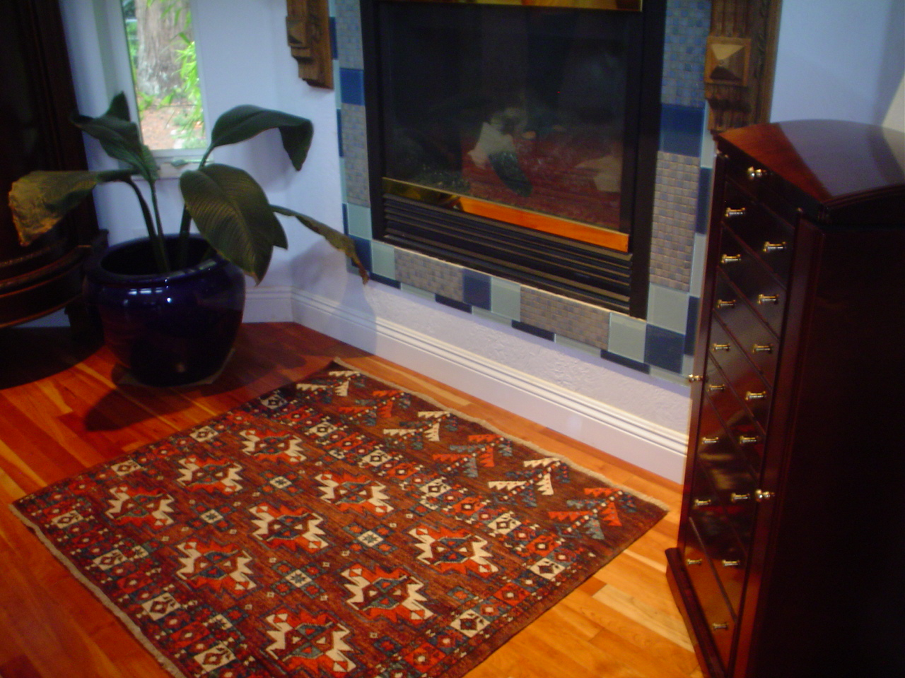 Small Turkoman rug in front of the fireplace.