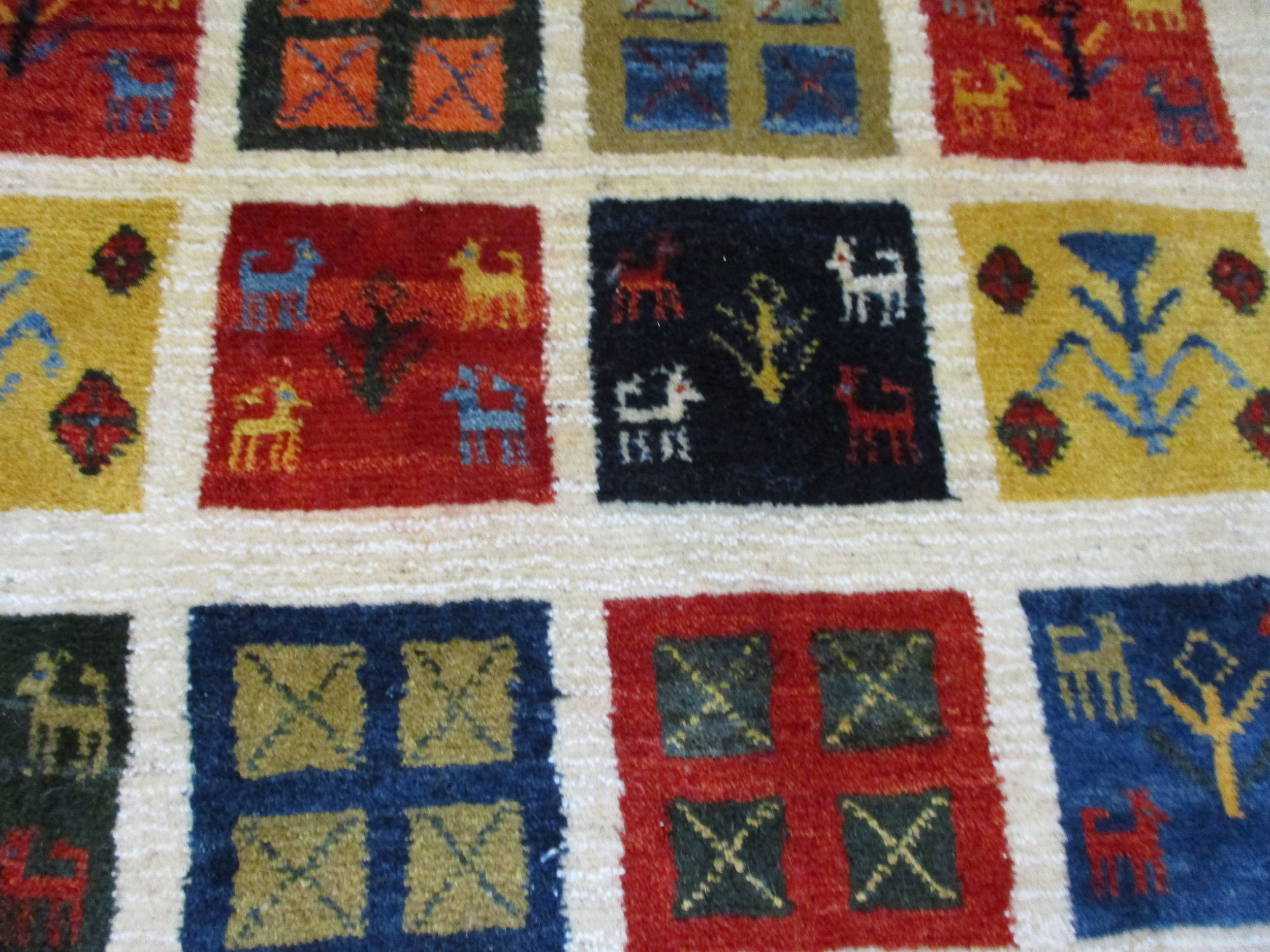 Gabbeh rug, close-up. Love the small animals.