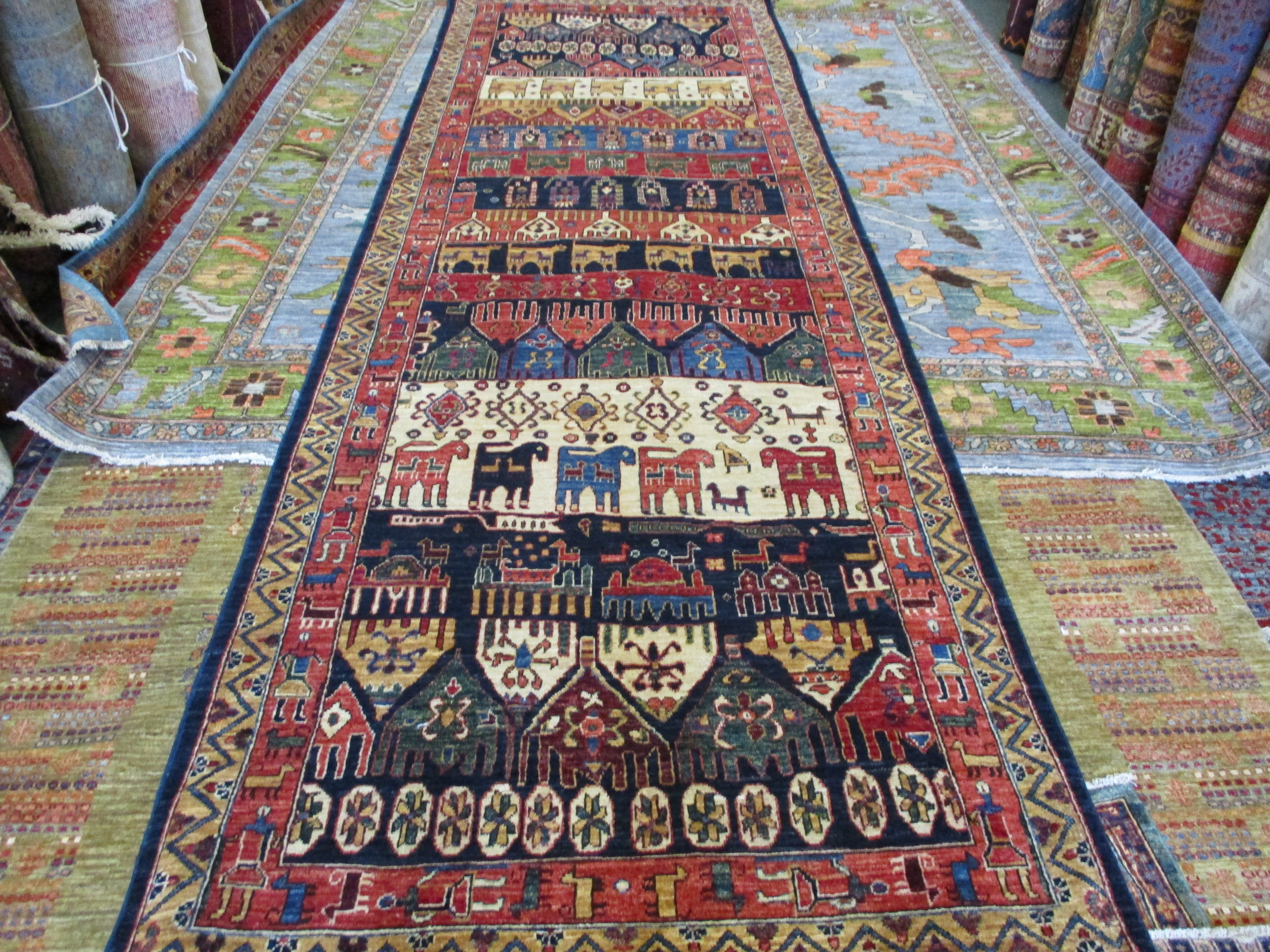 """Gallery size runner in a fantastic Persian tribal design. Woven in Afghanistan.  4'x 12'6"""""""