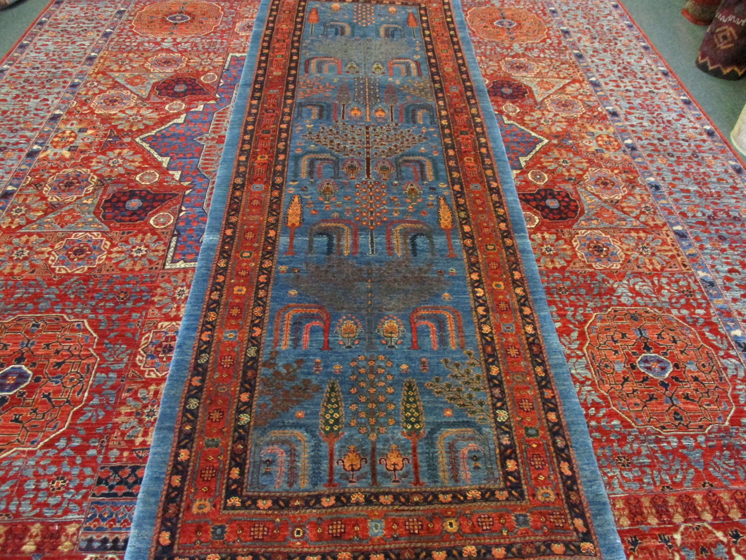 "8 ft. Persian runner (2'8 x 7'11"") in the Tree of Life design."