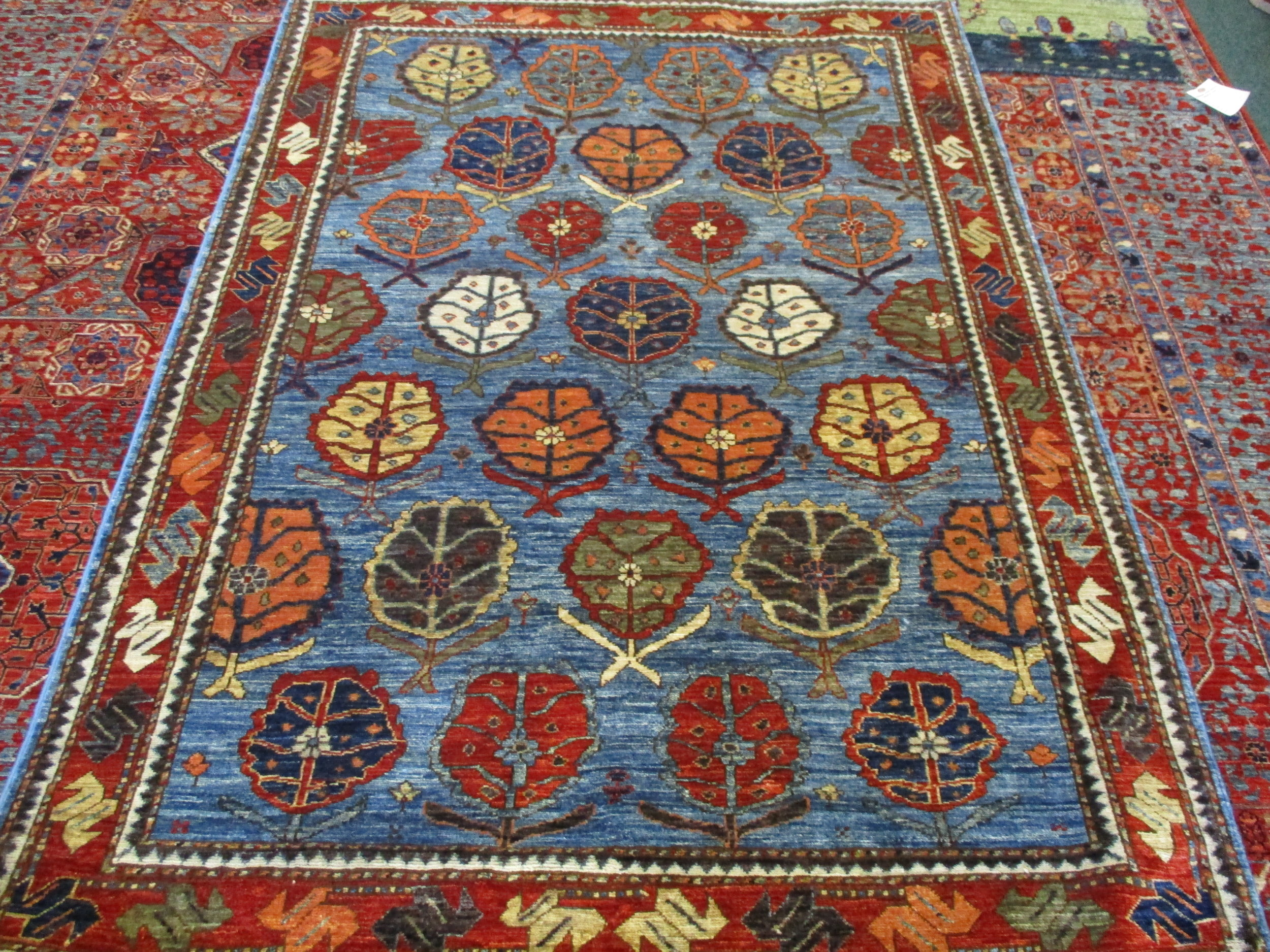 "#44) 4'2"" x 6' Beautiful Afghan rug in a leaf inspired tribal design."