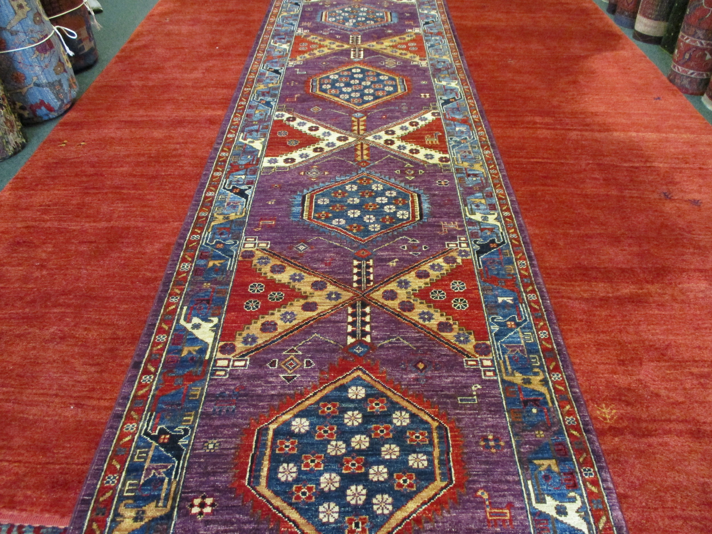 "#45) 2'11"" x 13'7"" Afghan runner in a Persian tribal design."