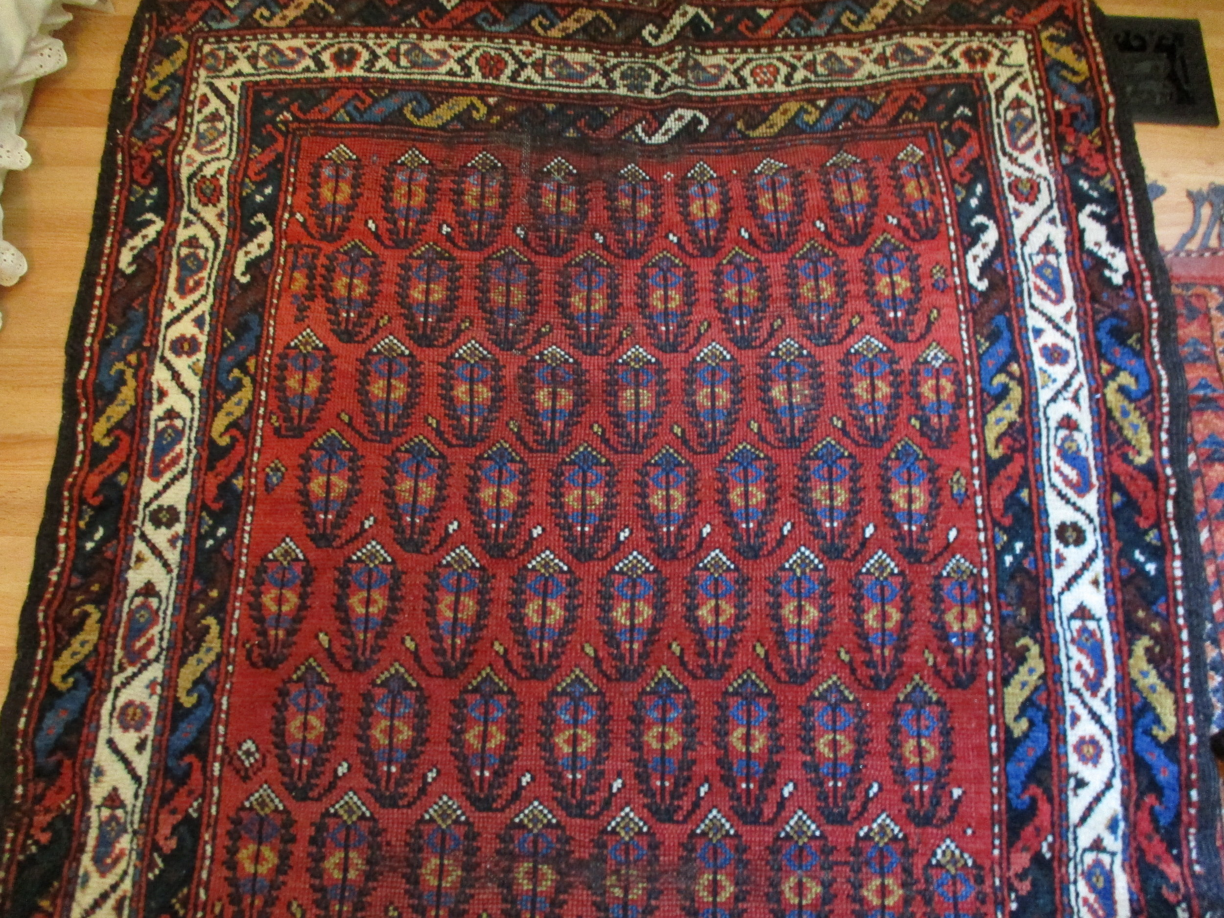 Antique Persian Luri runner. Overall boteh design with a gorgeous border. Some wear but still quite beautiful.