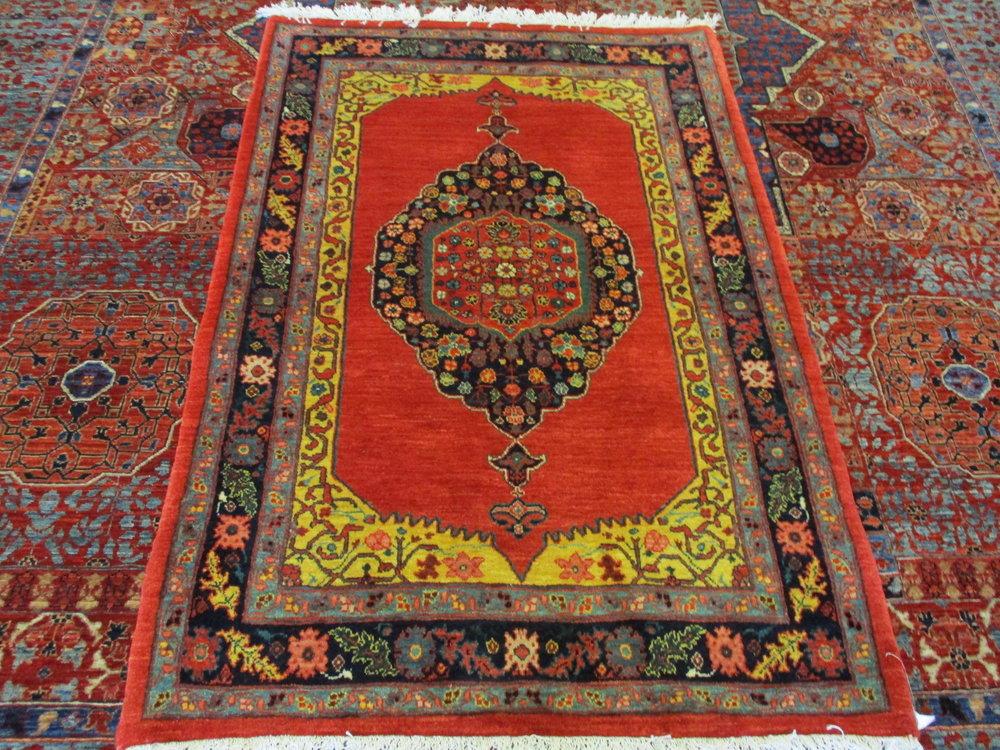 Small Bijar rug in beautiful colors.
