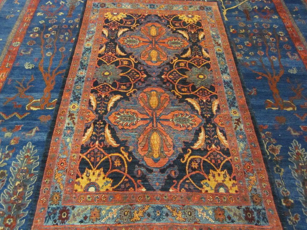 Here is a Persian rug. This is a new rug, from Iran, woven recently in an antique design. The rug was woven with hand-spun wool, dyed with vegetable or plant based dyes.