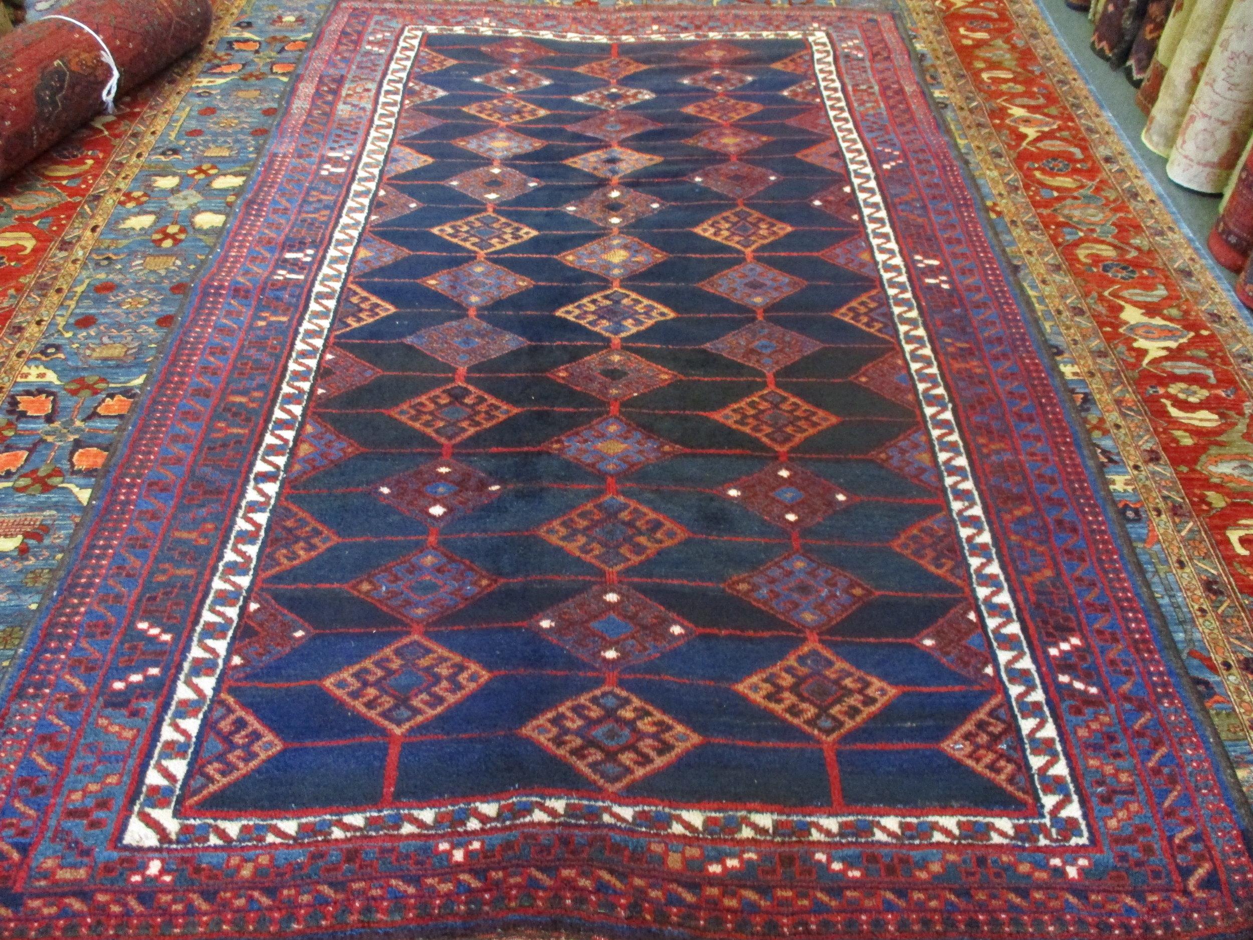 "5'2"" x 8'2"" Vintage Kurdish rug in deep, rich colors."