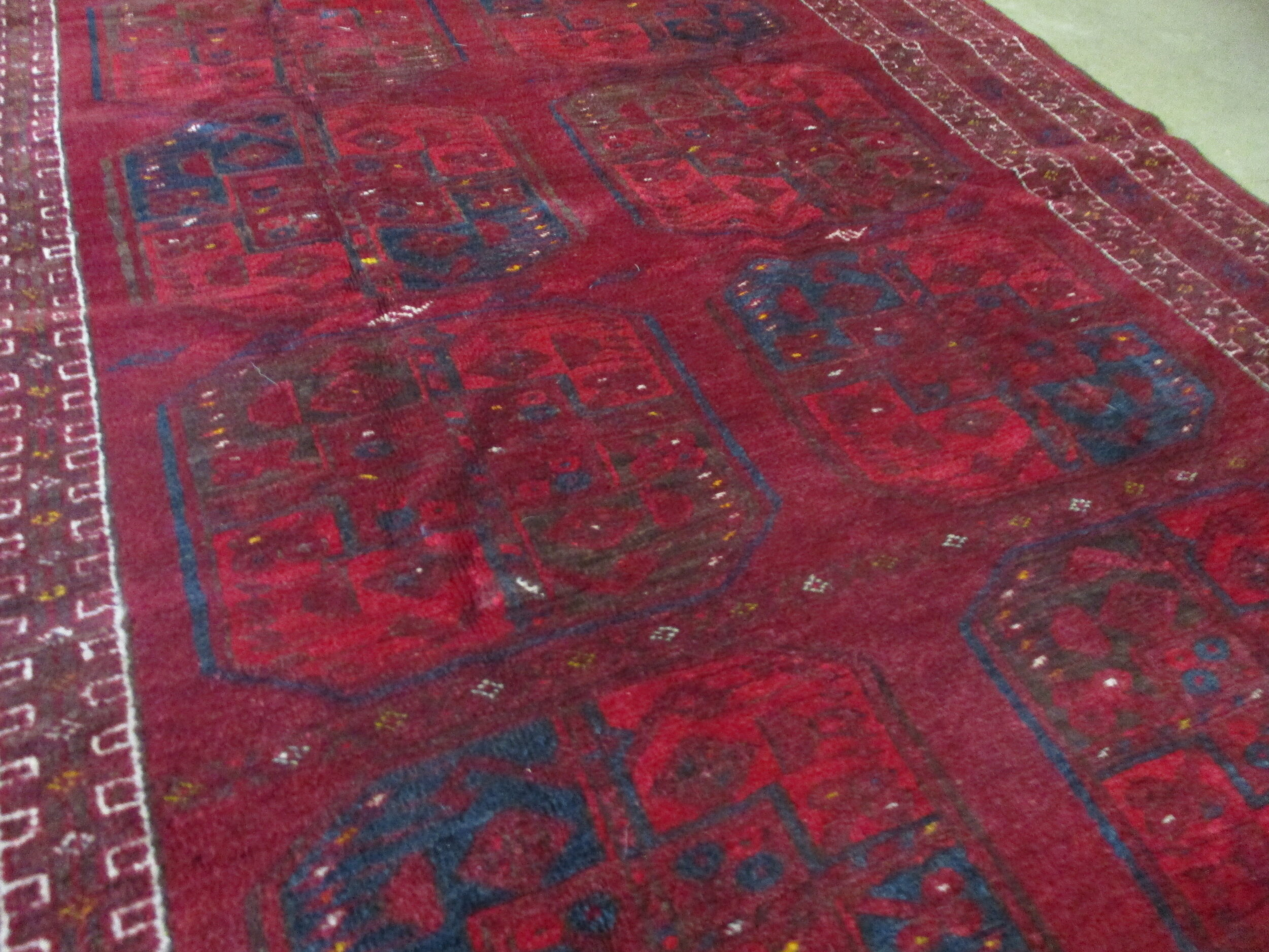 Beautiful old Turkoman rug with the deep, rich reds. Love this piece. Very small increments of a golden yellow, which add a lovely sparkle.