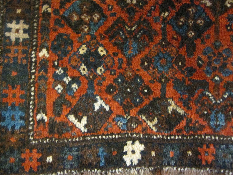 Small vintage Shiraz rug. Close-up.