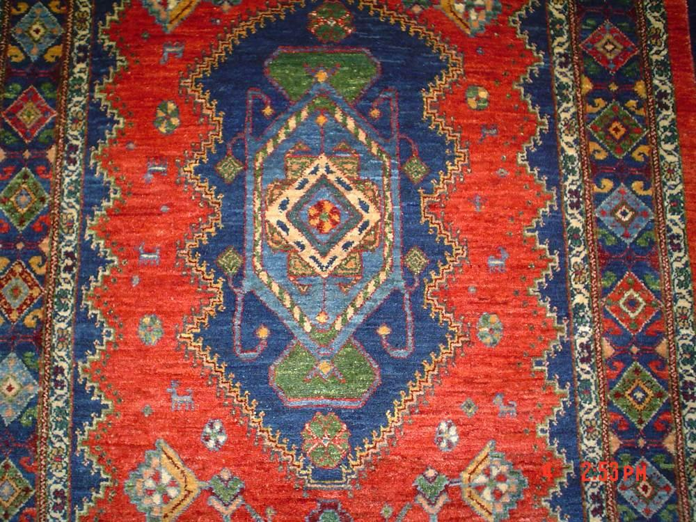 Note the small diamond in the center medallion and also in the borders of this Qasqai runner.