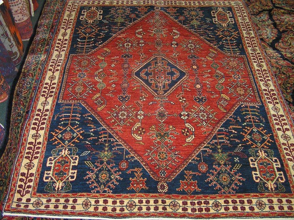 Recently woven 5 x 7 Persian Qashqai rug in a classic Qashqai design.