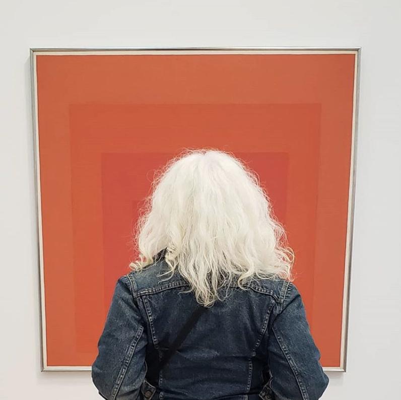 Amanda looking at a Josef Albers