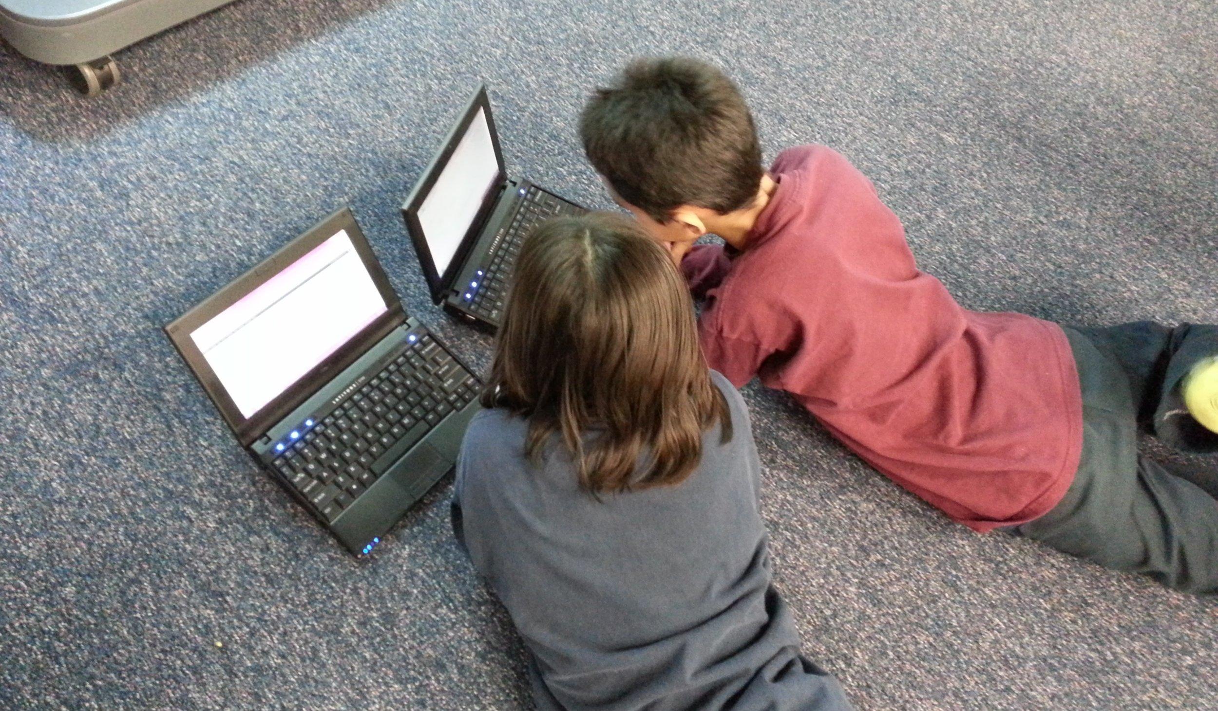 2 kids on laptops.jpg