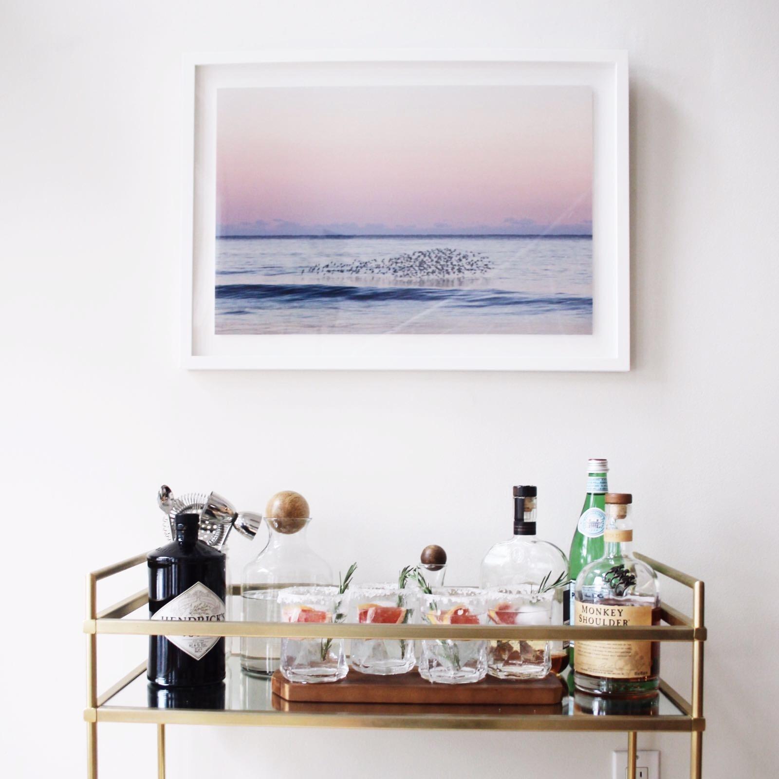 Print: Lauren Marttila Photography ; Bar Cart: West Elm ; Glasses: West Elm