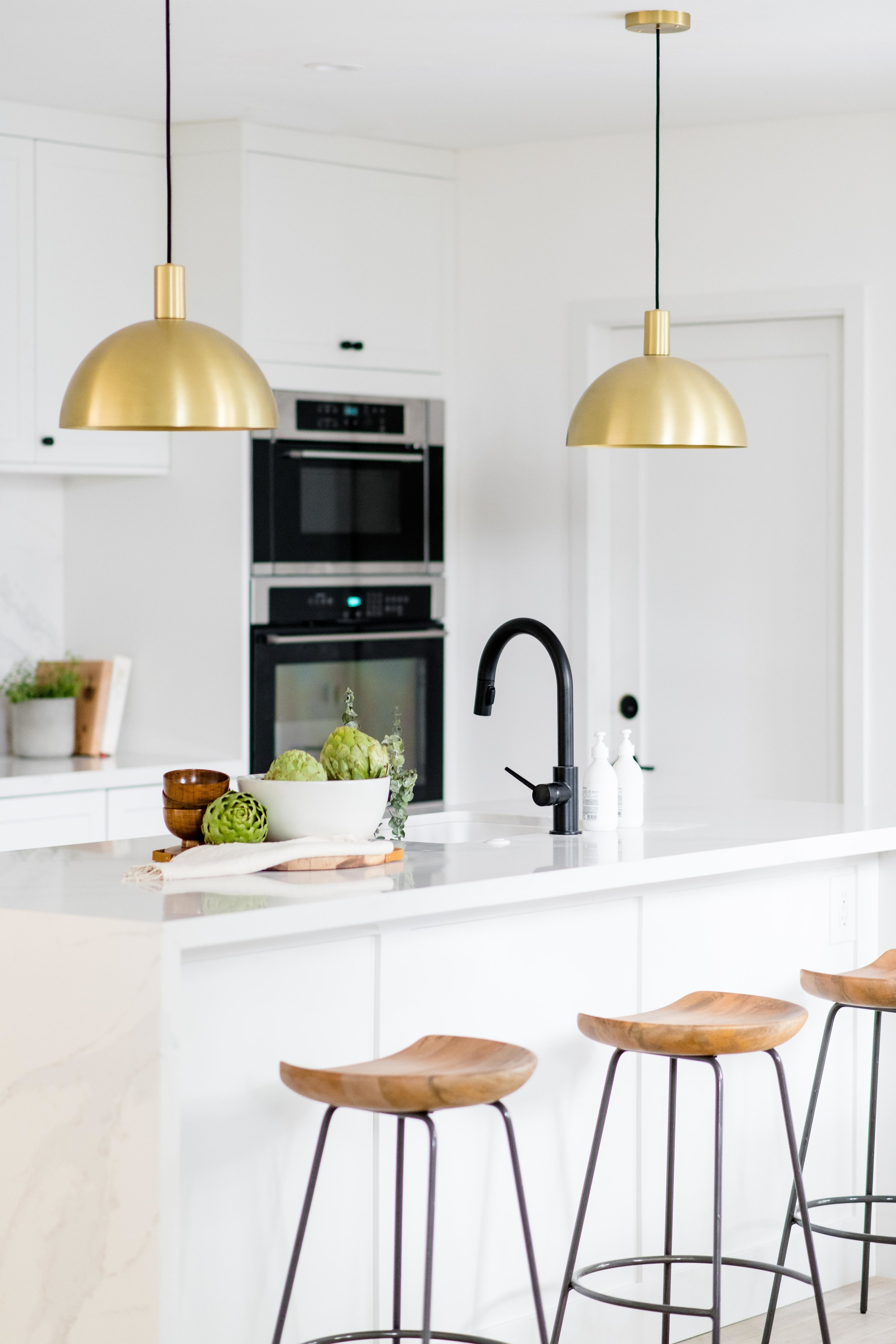 white kitchen island with barstools and brass pendants - the habitat collective interior design - #projectpeachy