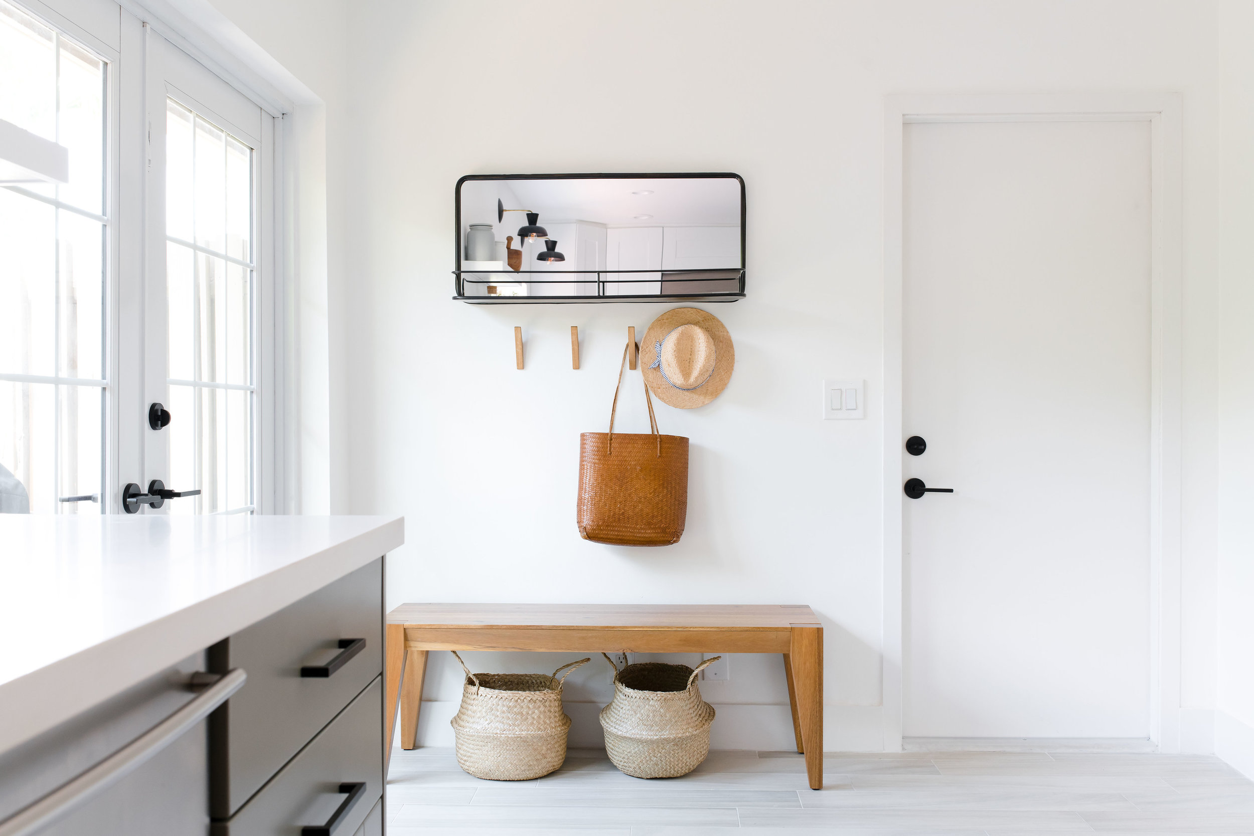 modern entryway bench, metal mirror, wooden hooks - the habitat collective - project casinha linda