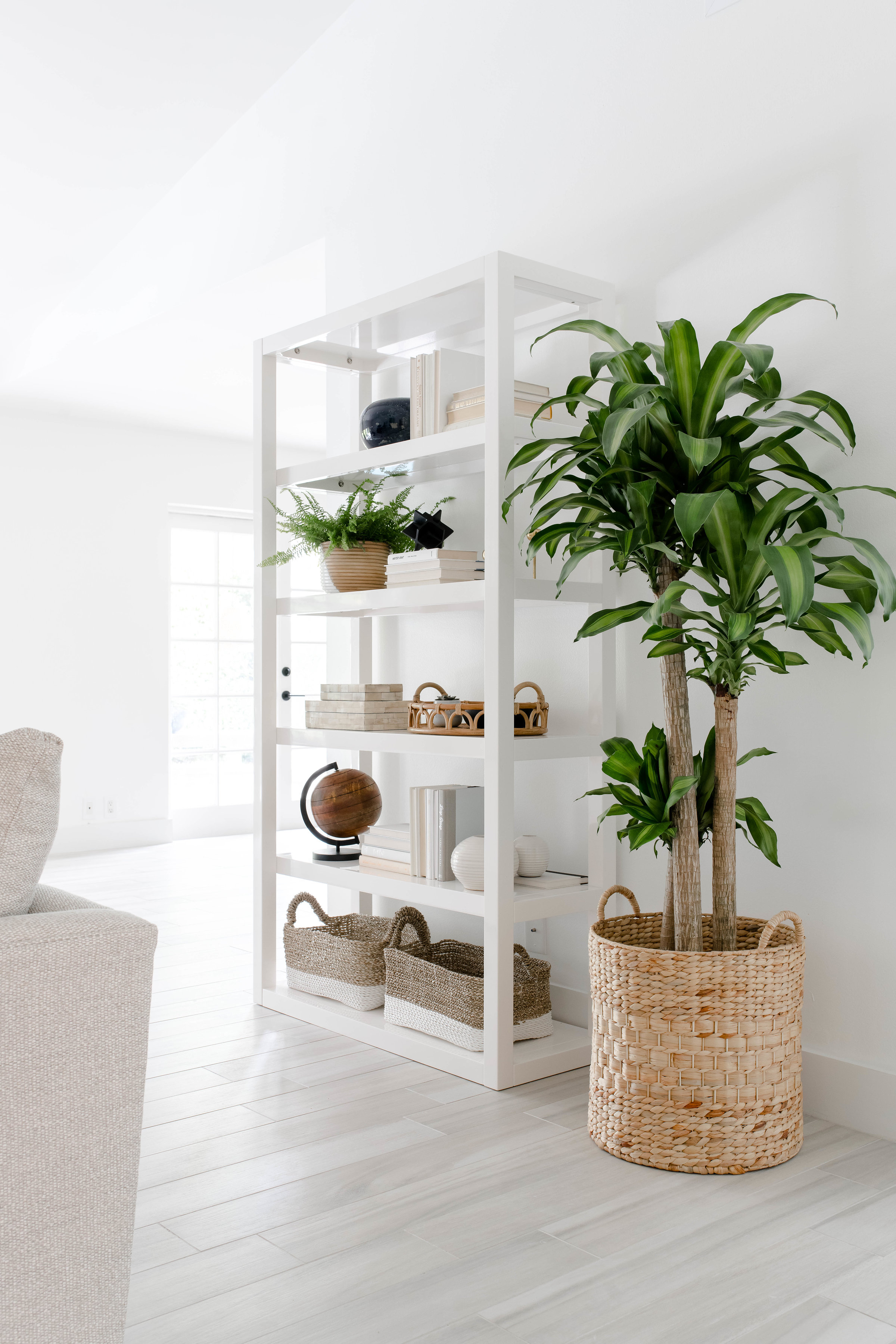open shelf styling in modern living room - the habitat collective - project casinha linda